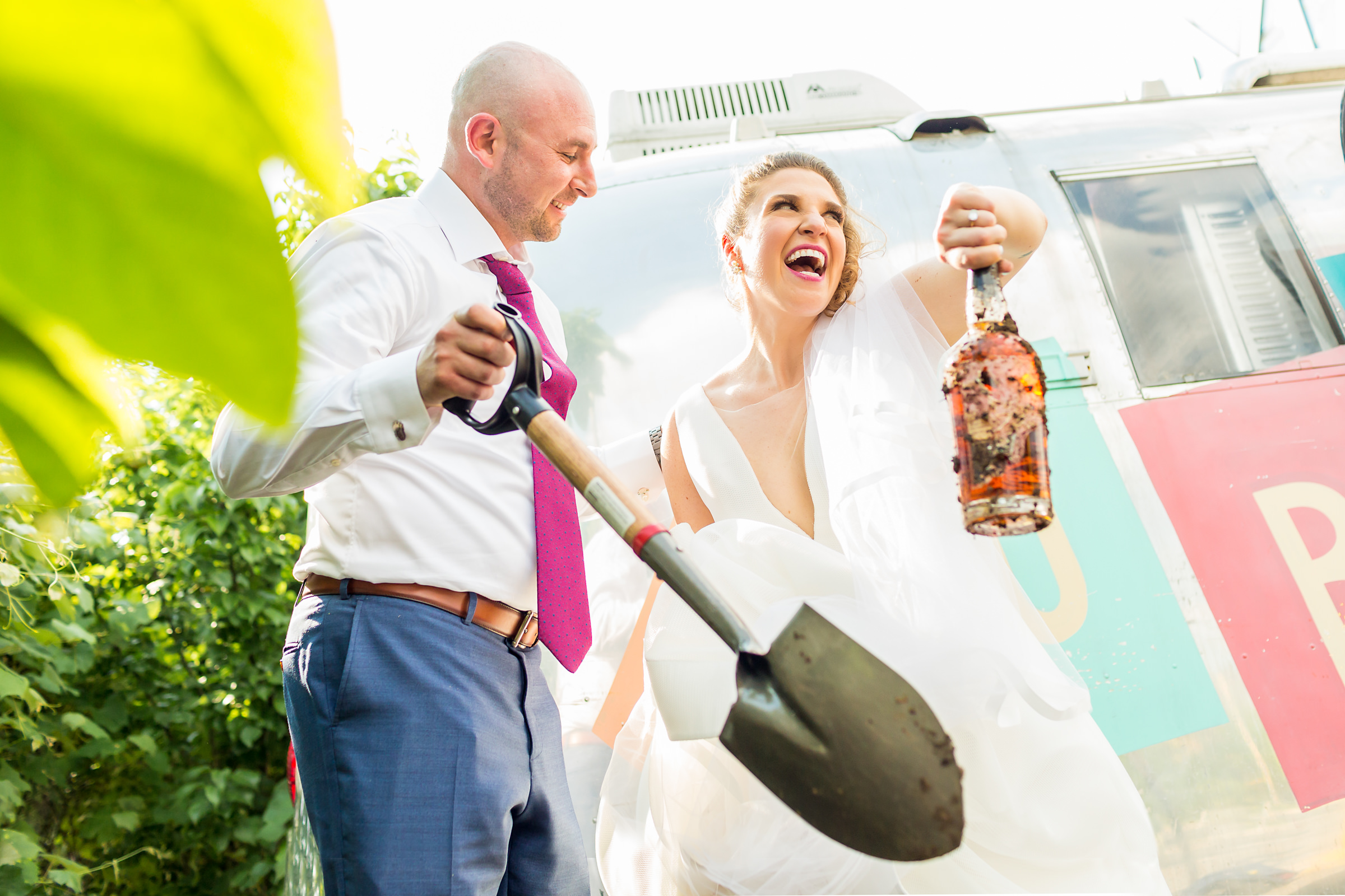 Couple with shovel unearth bottle - photo by Procopio Photography