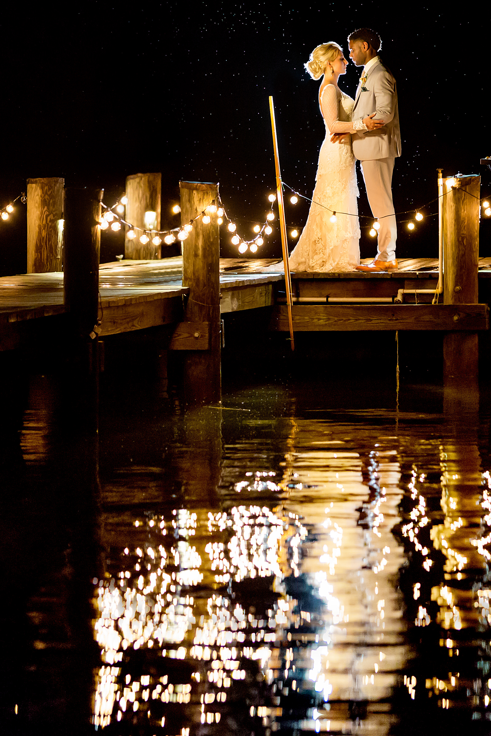 Face to face couple portrait outdoors nighttime with string lights - photo by Procopio Photography