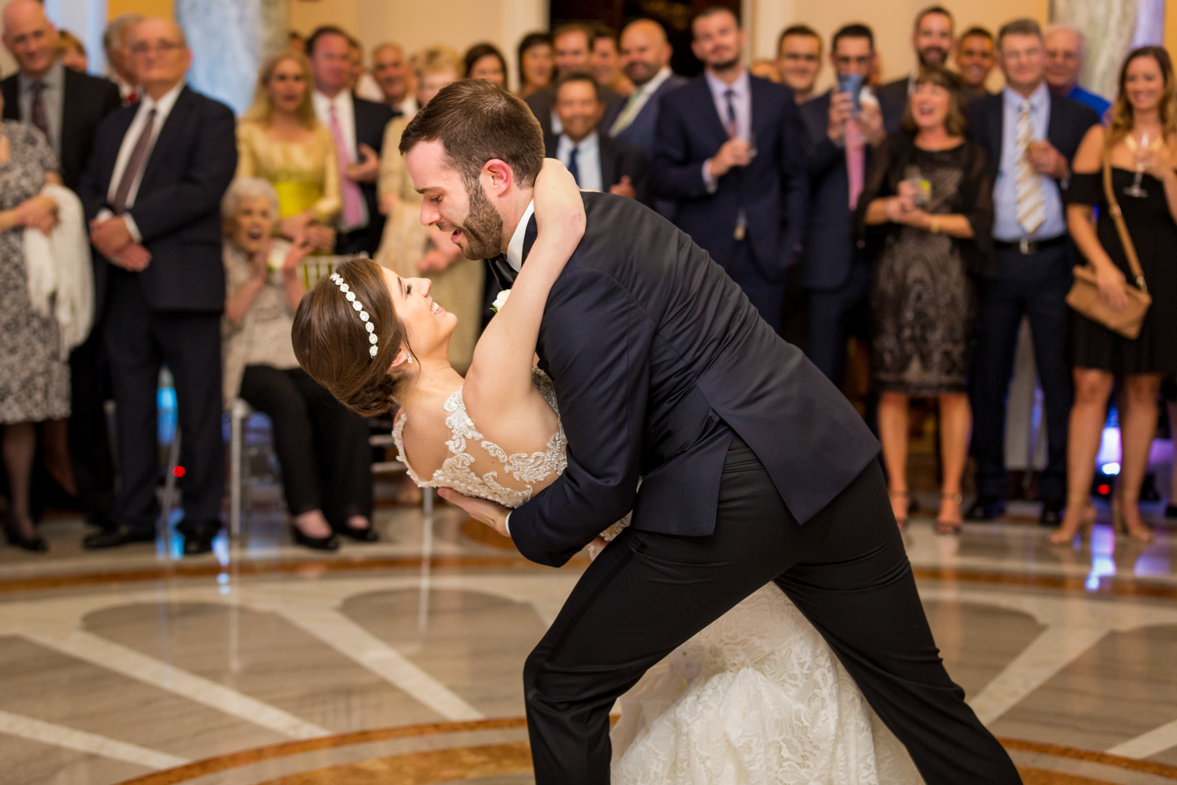 Groom dips bride at first dance - photo by Procopio Photography