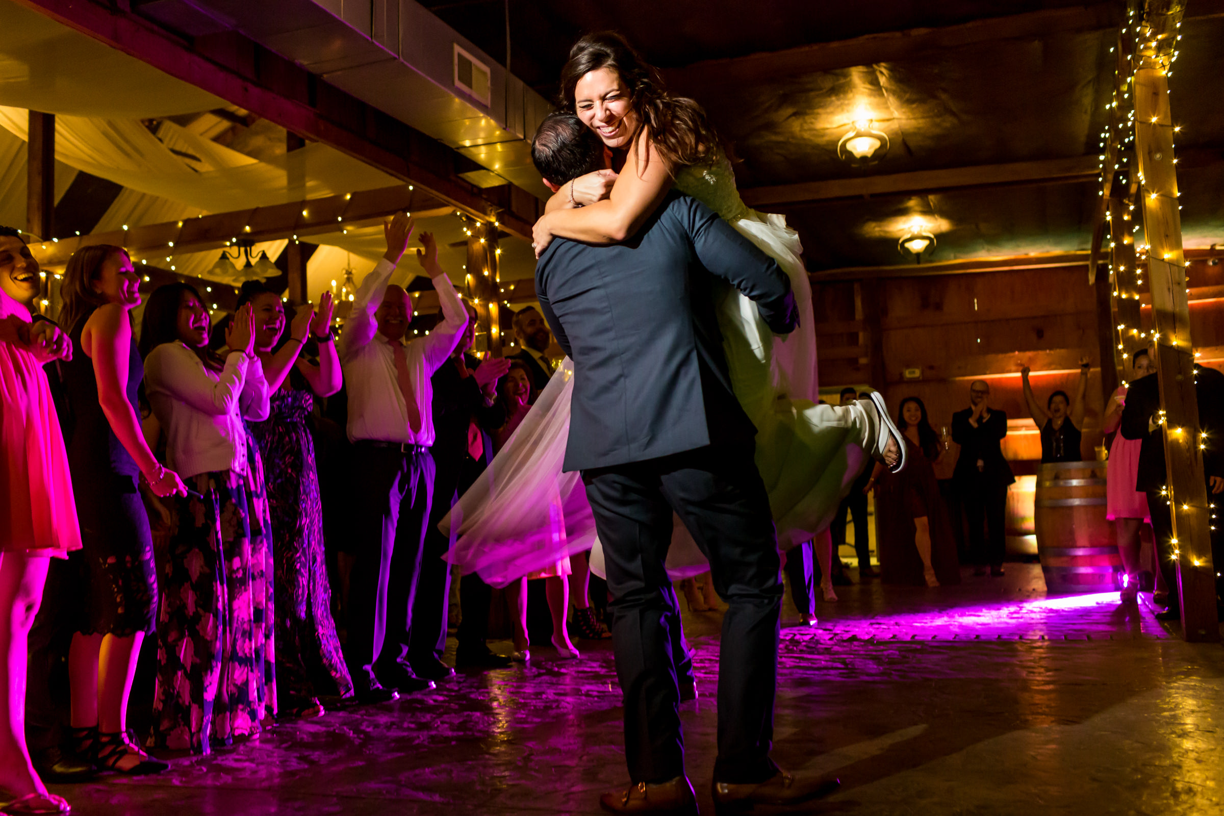 Groom lifts bride at dance - photo by Procopio Photography