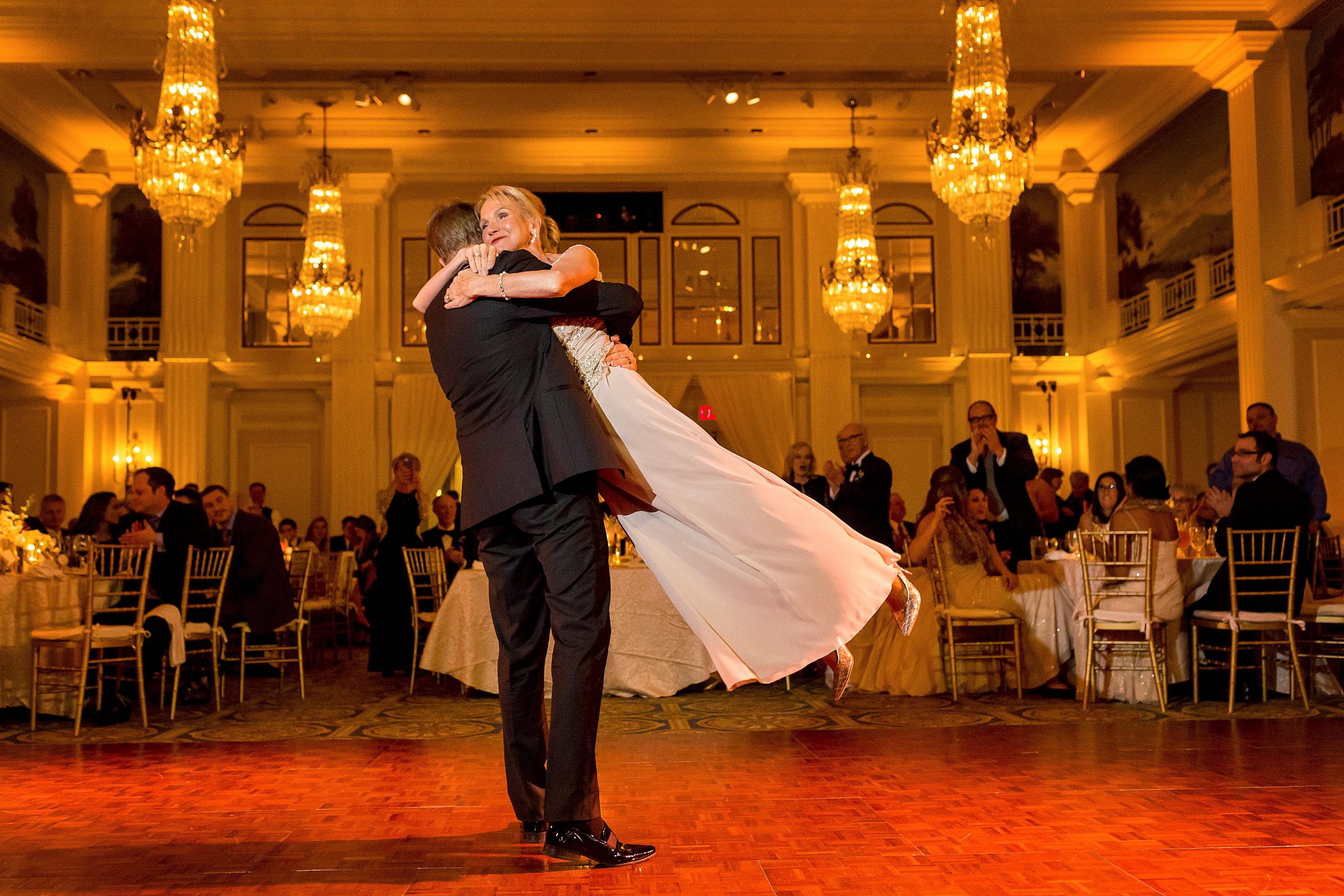 Groom lifts bride in dance - photo by Procopio Photography