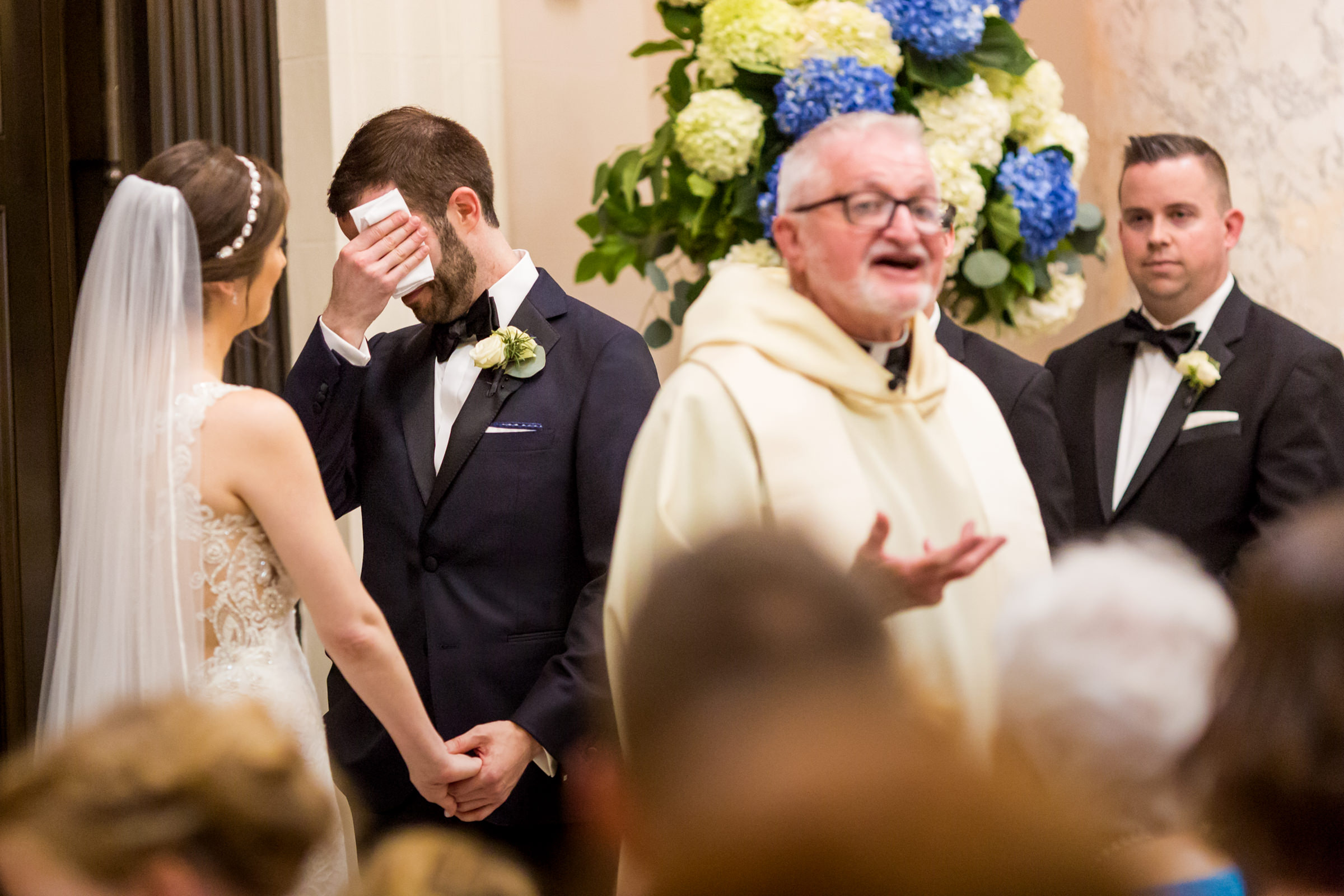 Groom wiping his brow with bride and officiant - photo by Procopio Photography