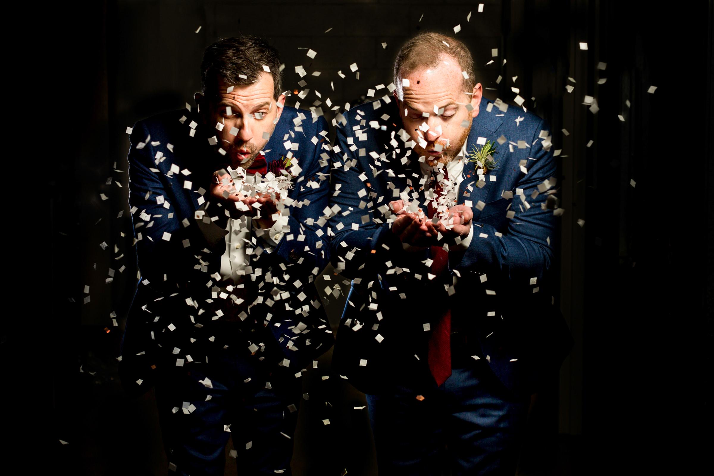 Groomsmen dispersing confetti - photo by Procopio Photography