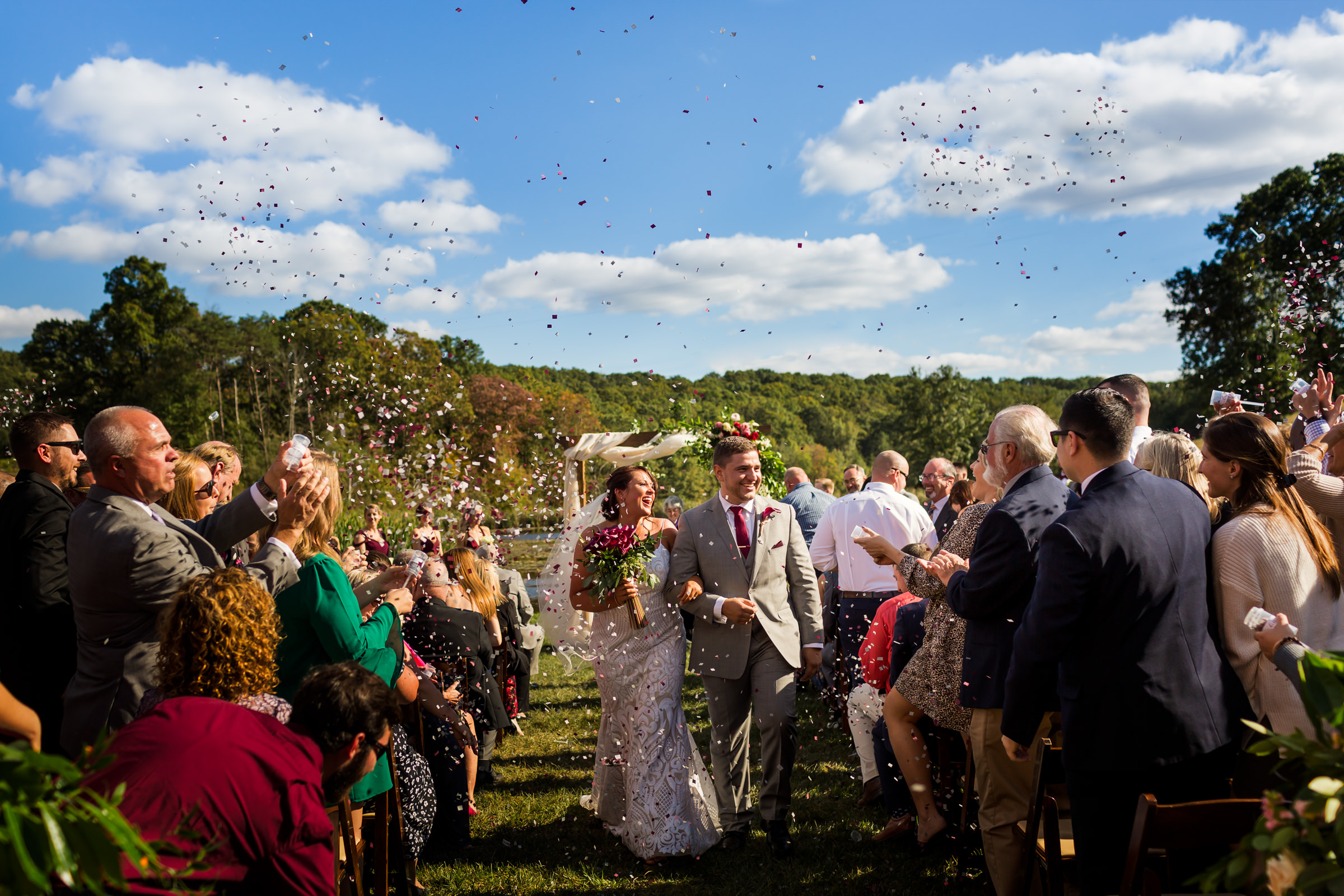 Just married couple leaves ceremony under rose petals - photo by Procopio Photography
