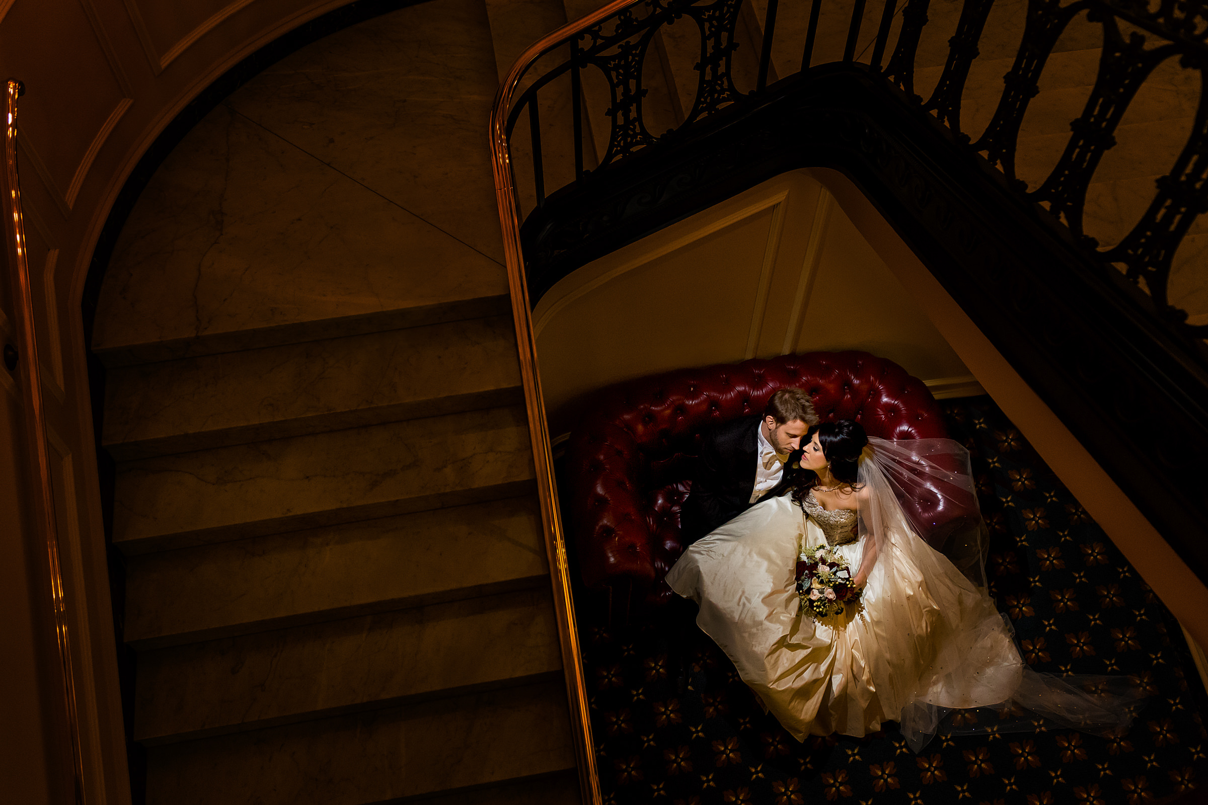 Luxury couple through spiral staircase - photo by Procopio Photography