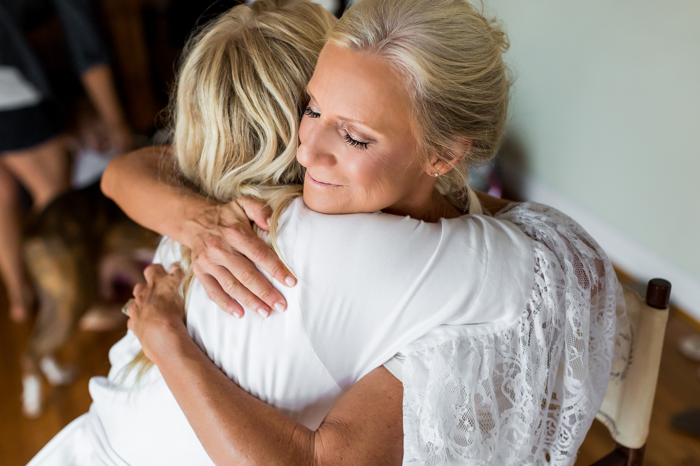 Mother and bride embrace - photo by Procopio Photography