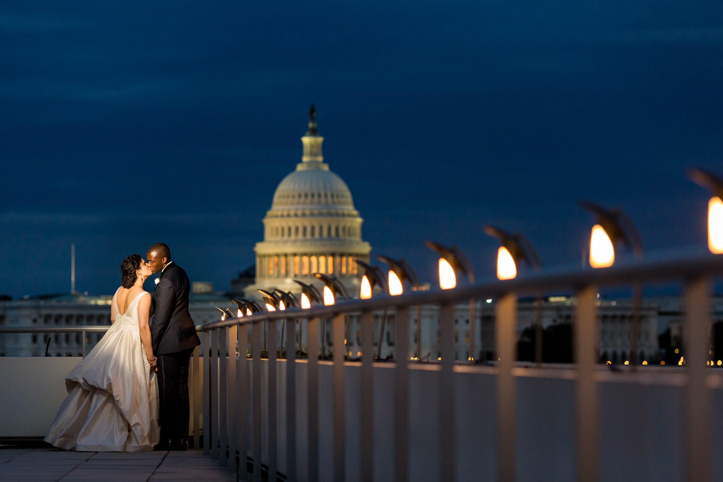 Nighttime couple portrait against capitol - photo by Procopio Photography