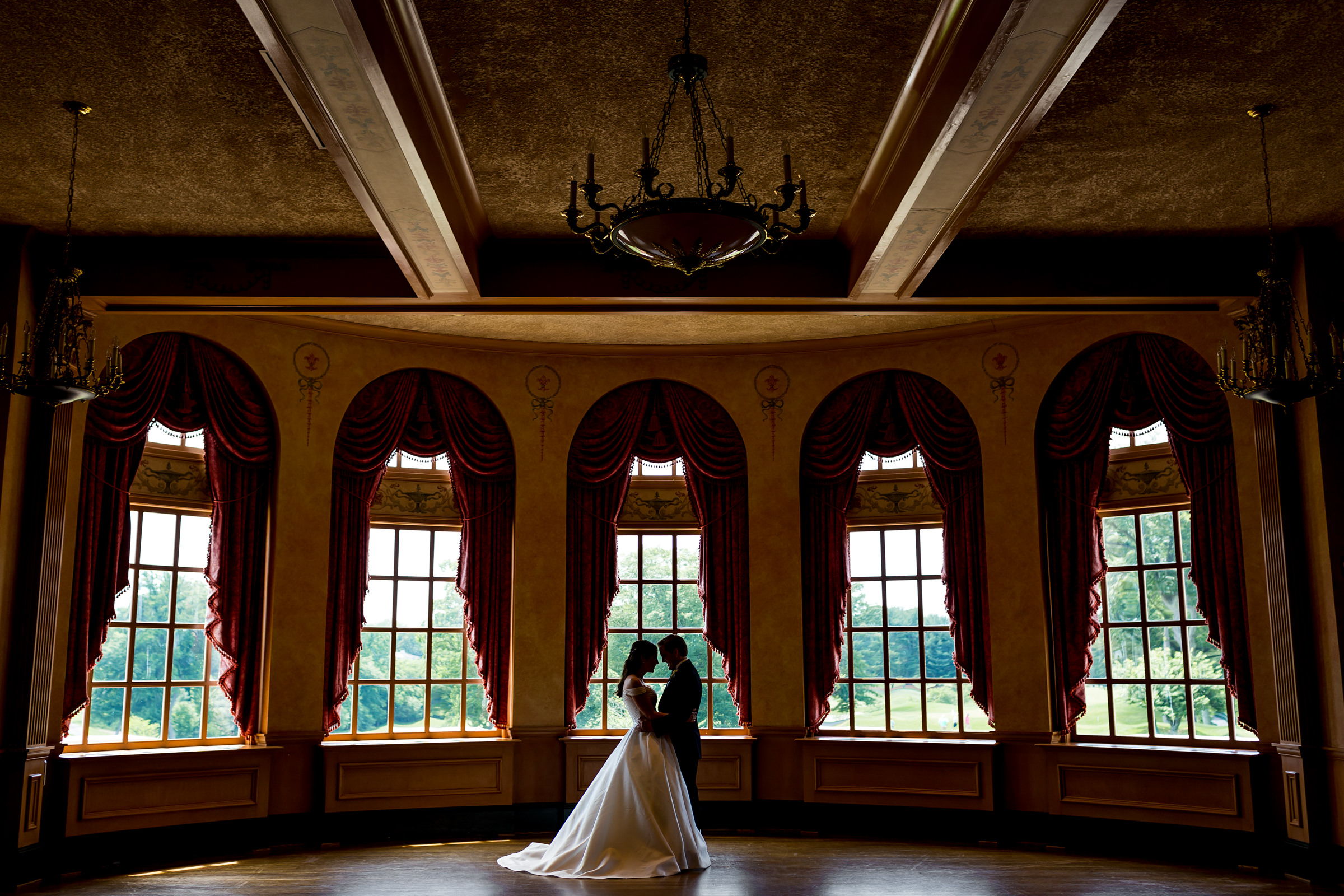 Partial silhouette couple in historic interior setting - photo by Procopio Photography