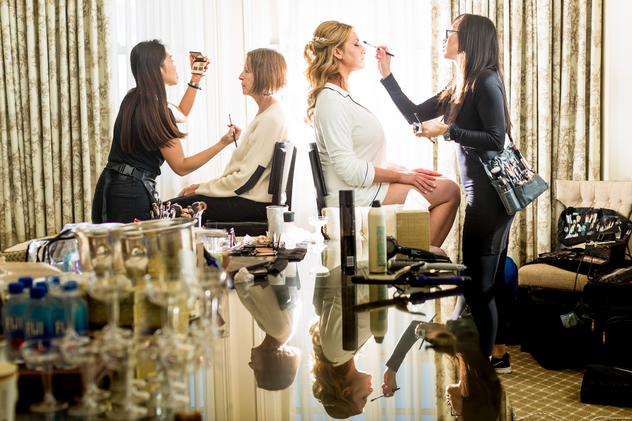 Reflected bride and mother having makeup applied - photo by Procopio Photography