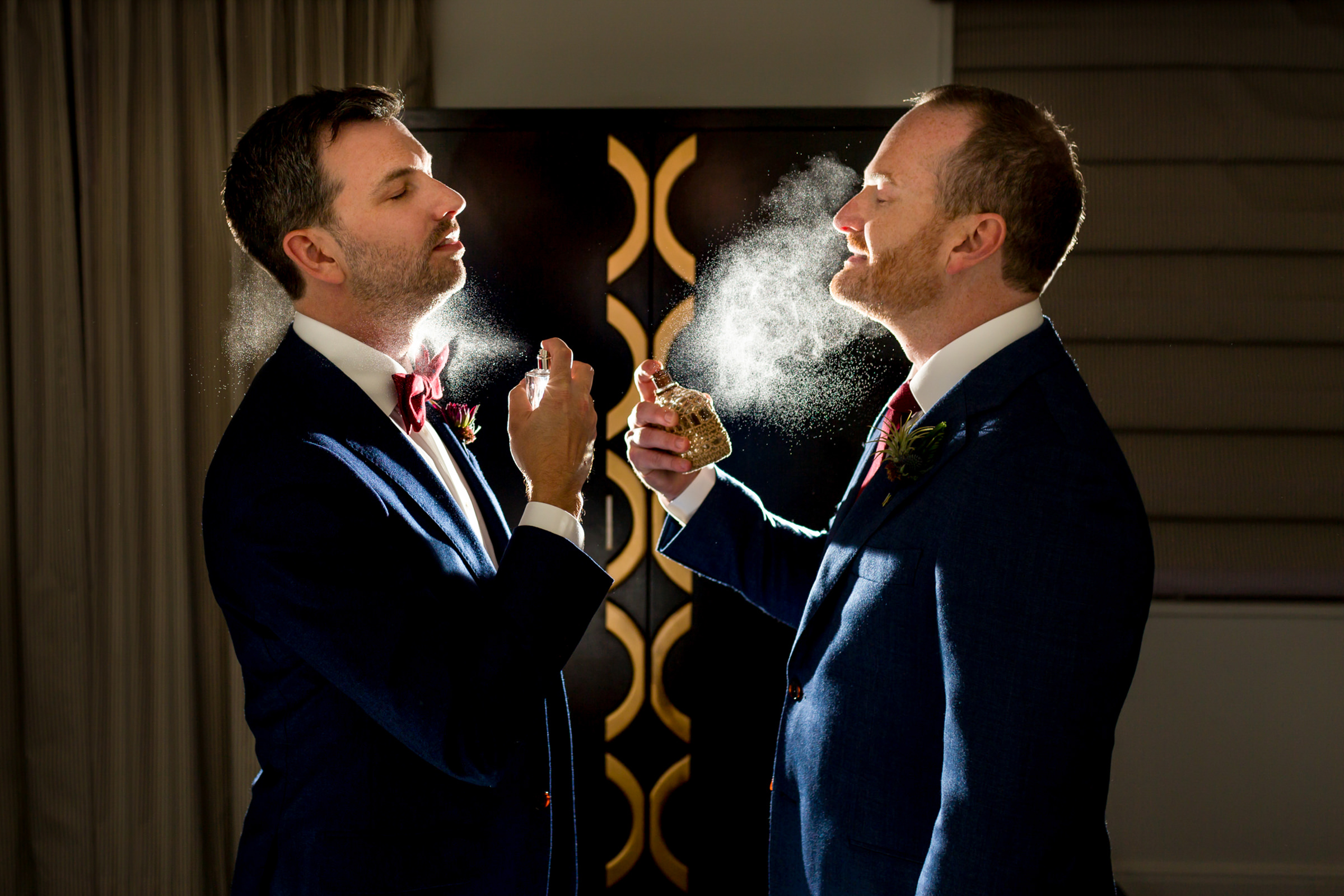 Two grooms in mist of cologne - photo by Procopio Photography
