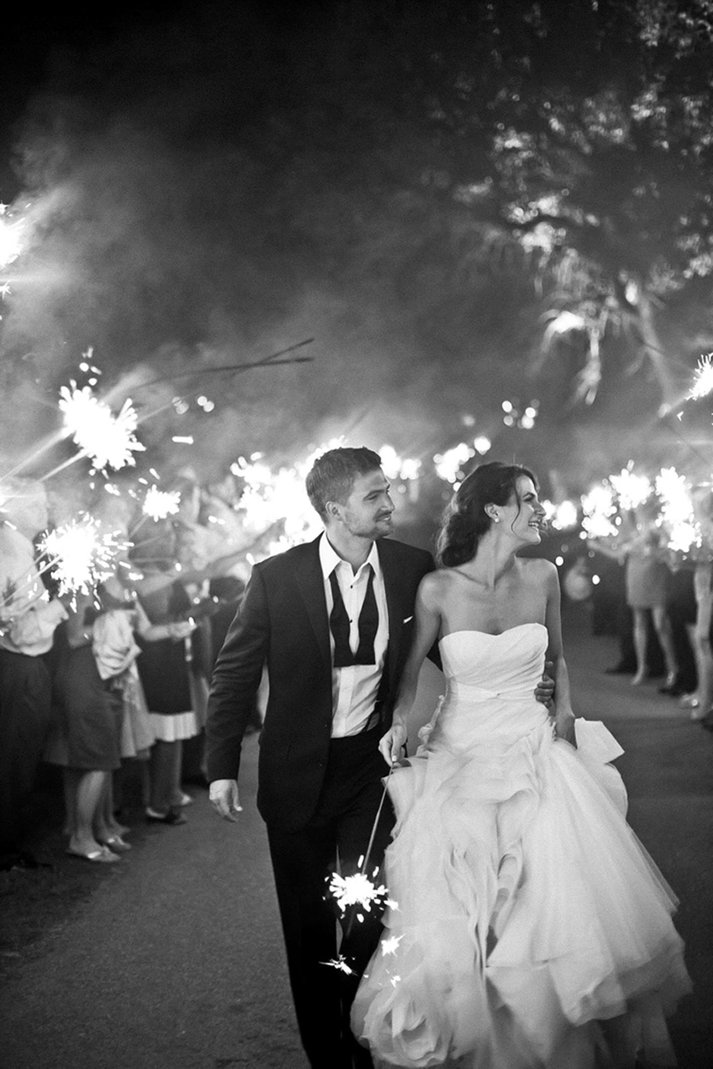 Couple exit amid sparklers - photo by Amy and Stuart Photography