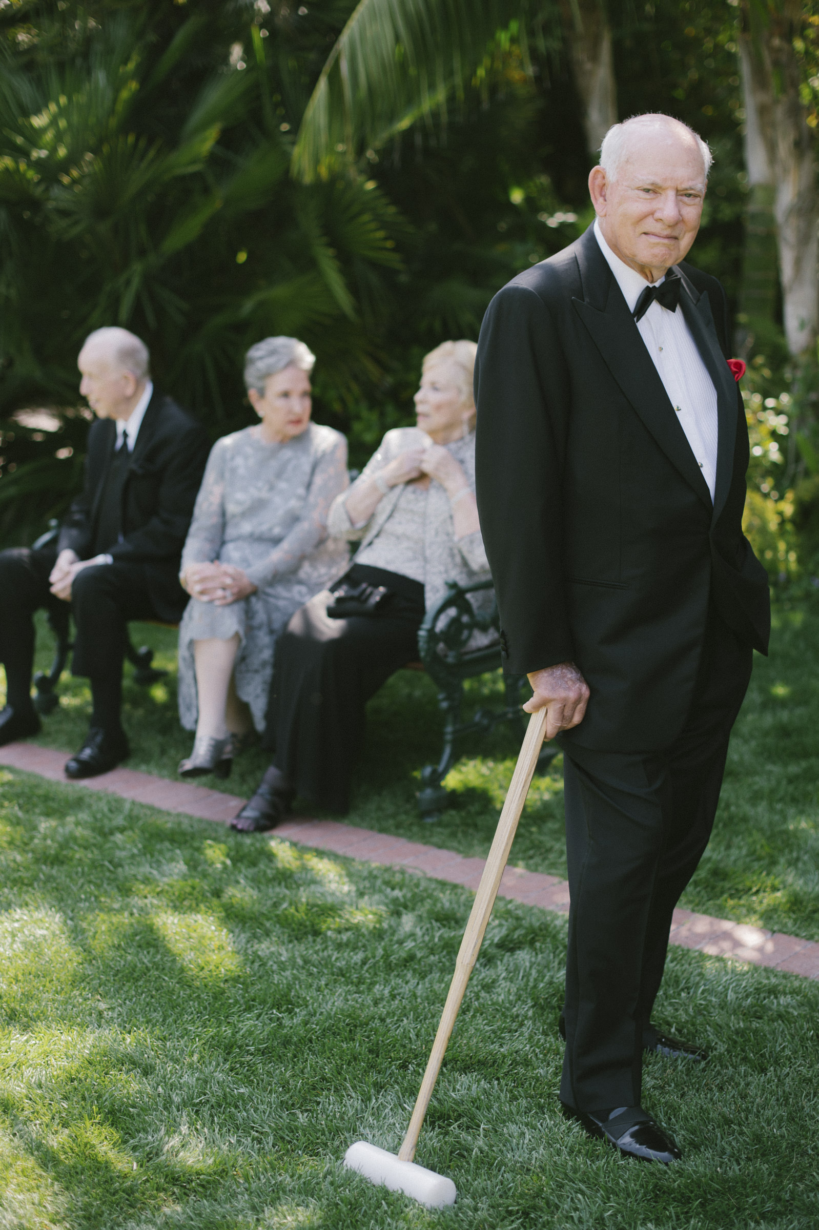 Elderly wedding guest with croquet mallet - photo by Amy and Stuart Photography