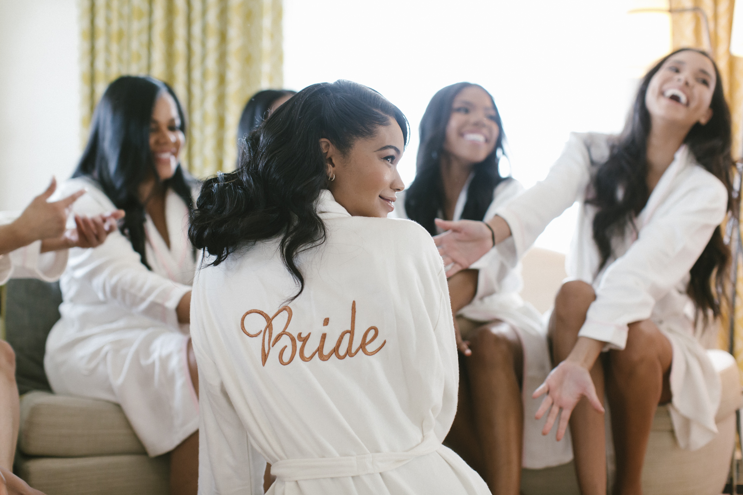 Glamorous bride and bridesmaids in robes getting ready - photo by Amy and Stuart Photography
