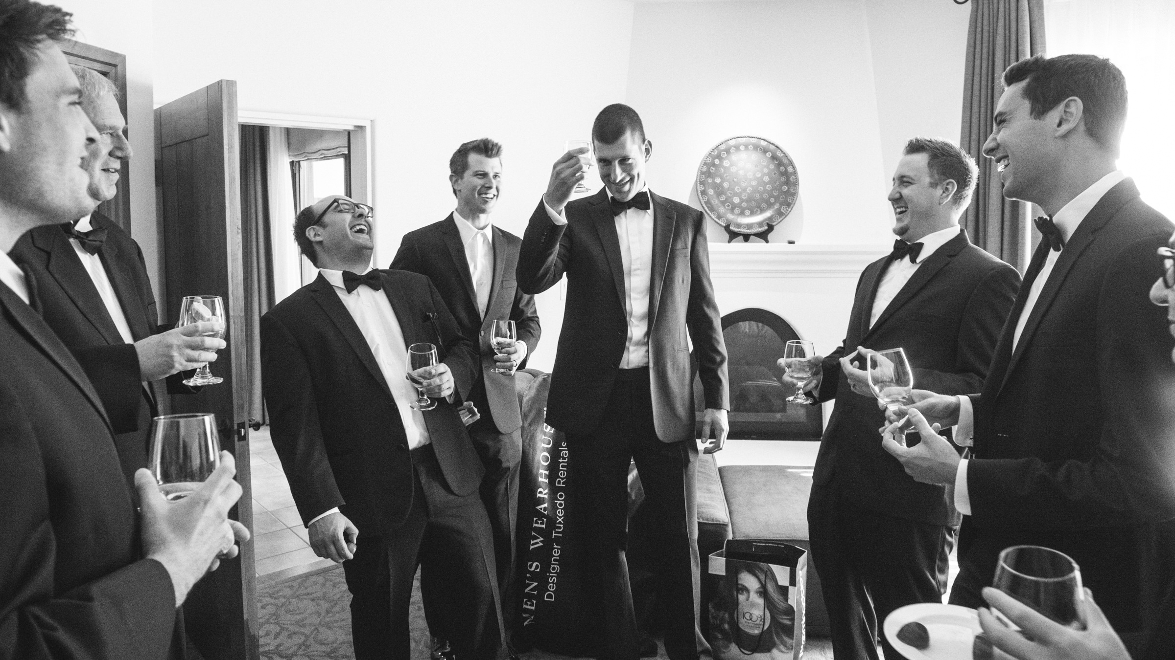 Groom and groomsmen toast - photo by Amy and Stuart Photography
