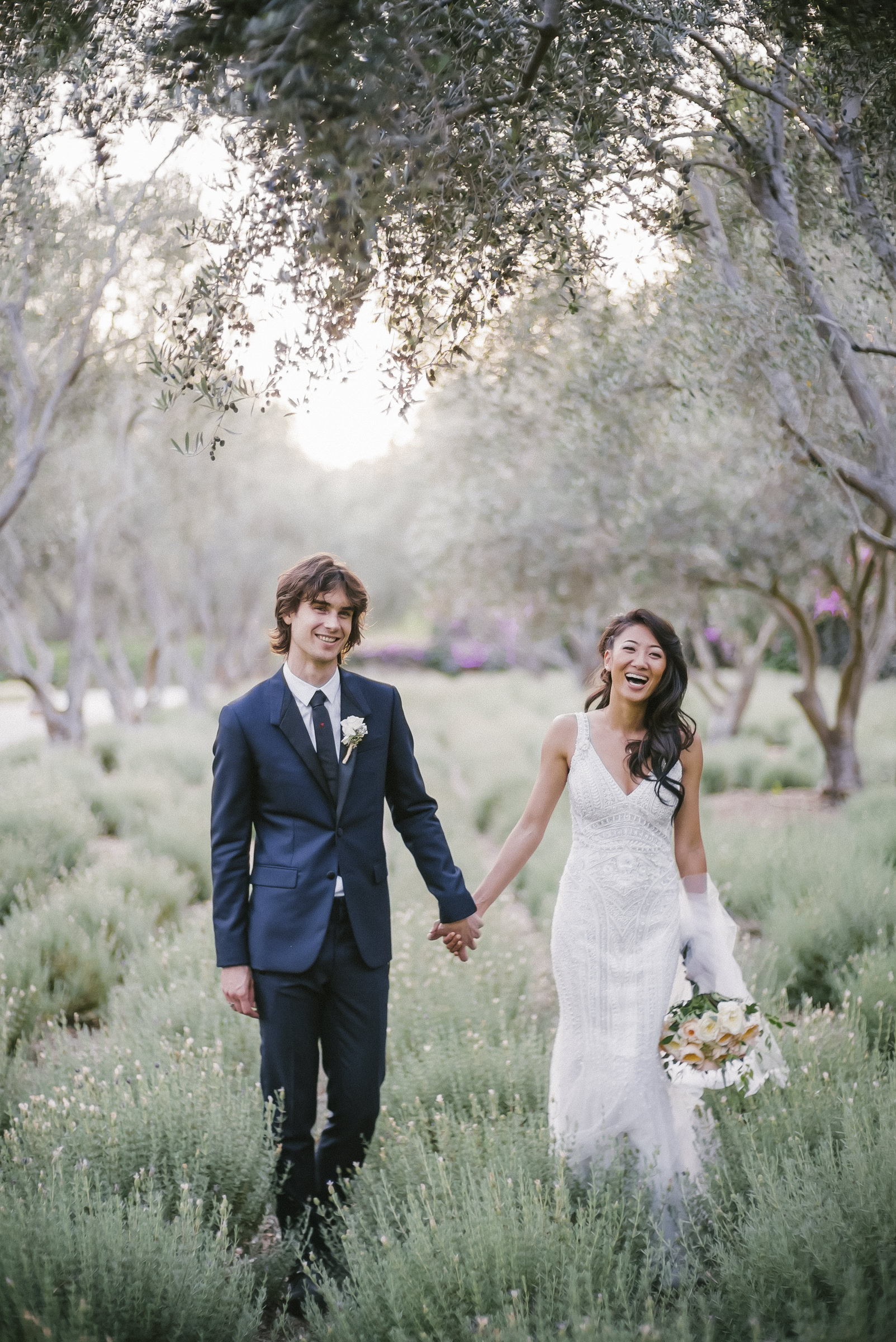Happy bride ad groom in lavender field- photo by Amy and Stuart Photography