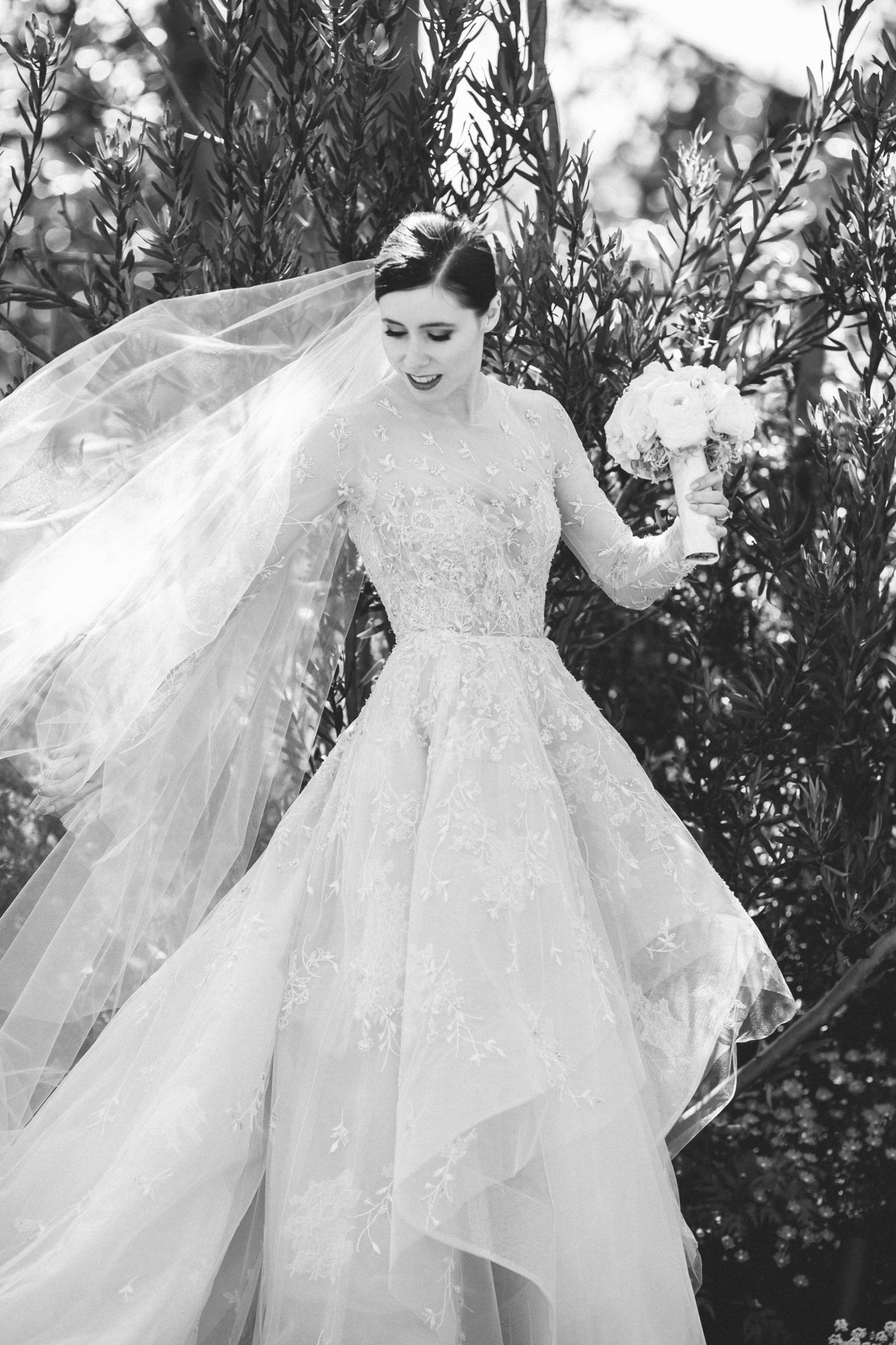 Portrait of bride in beaded long sleeve ballgown - photo by Amy and Stuart Photography