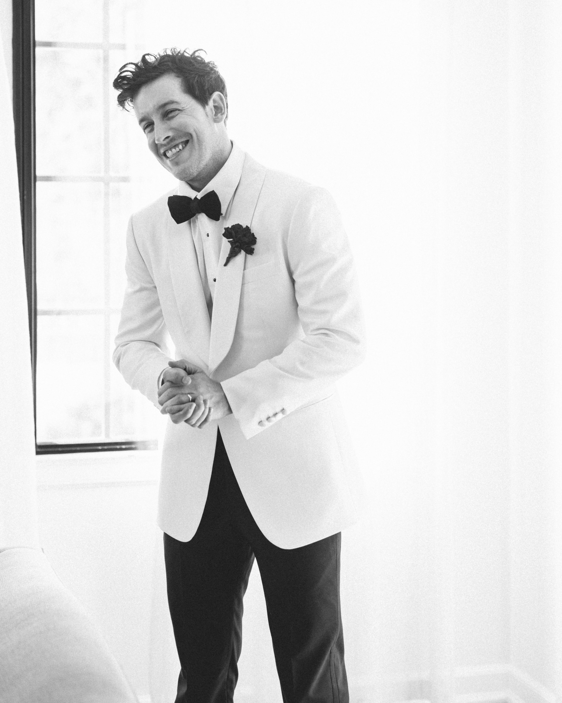Smiling groom - photo by Amy and Stuart Photography