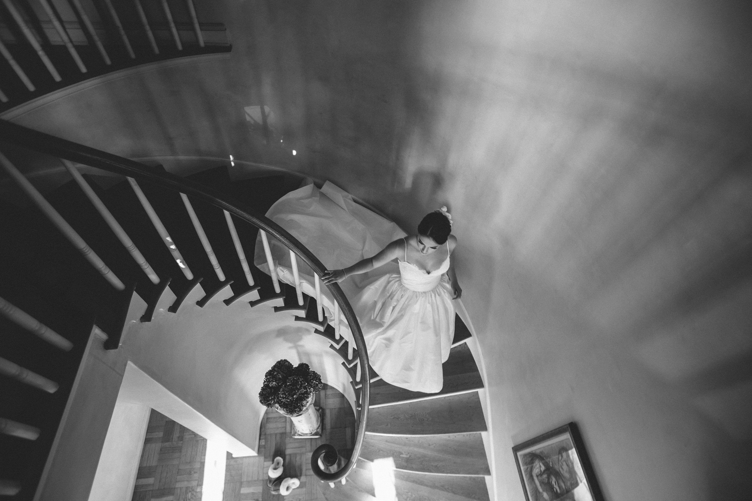 Top down view of bride descending spiral staircase - photo by Amy and Stuart Photography