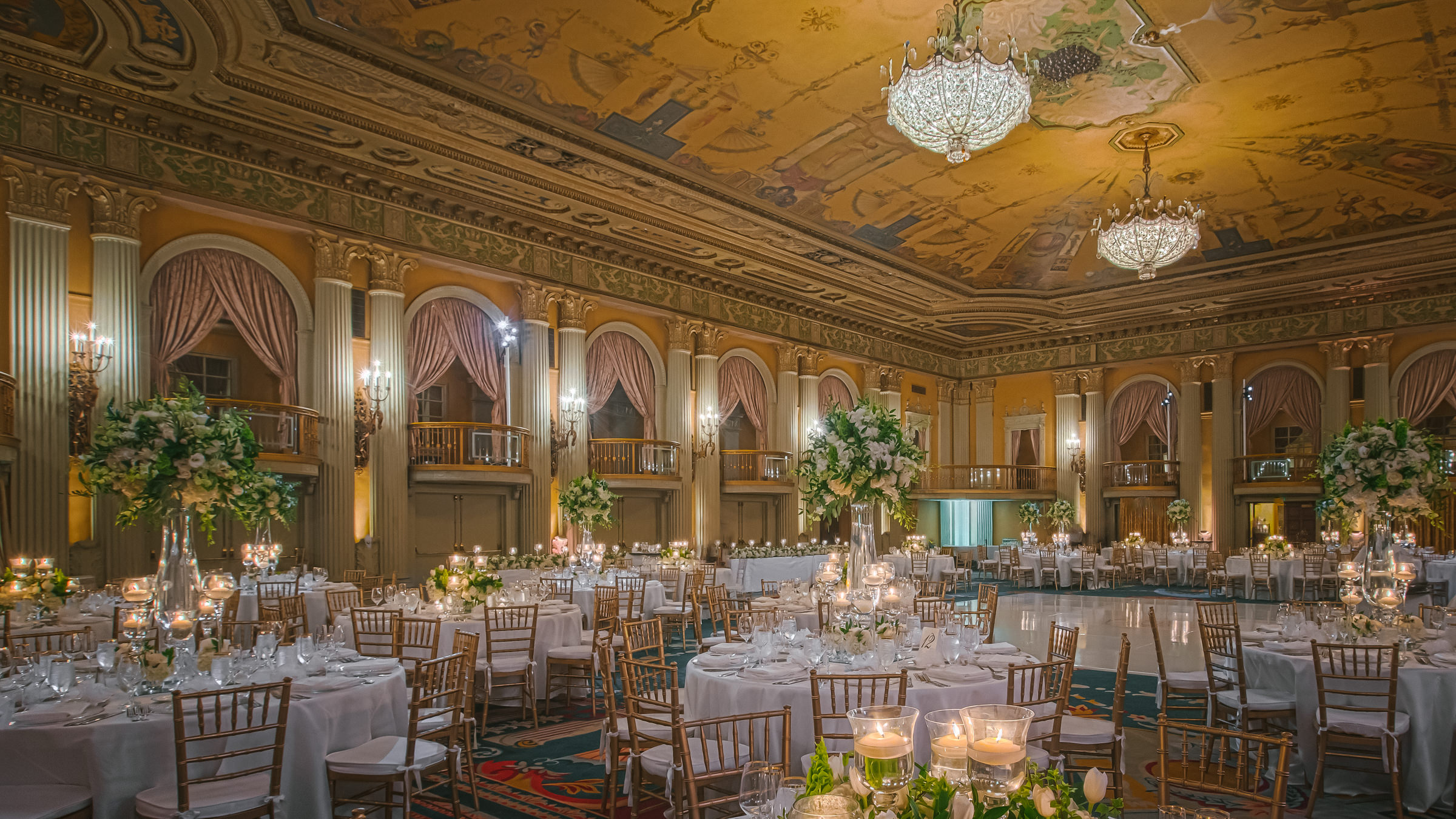 ballroom reception seating and decor with tall floral centerpieces- photo by Amy and Stuart Photography, los angeles