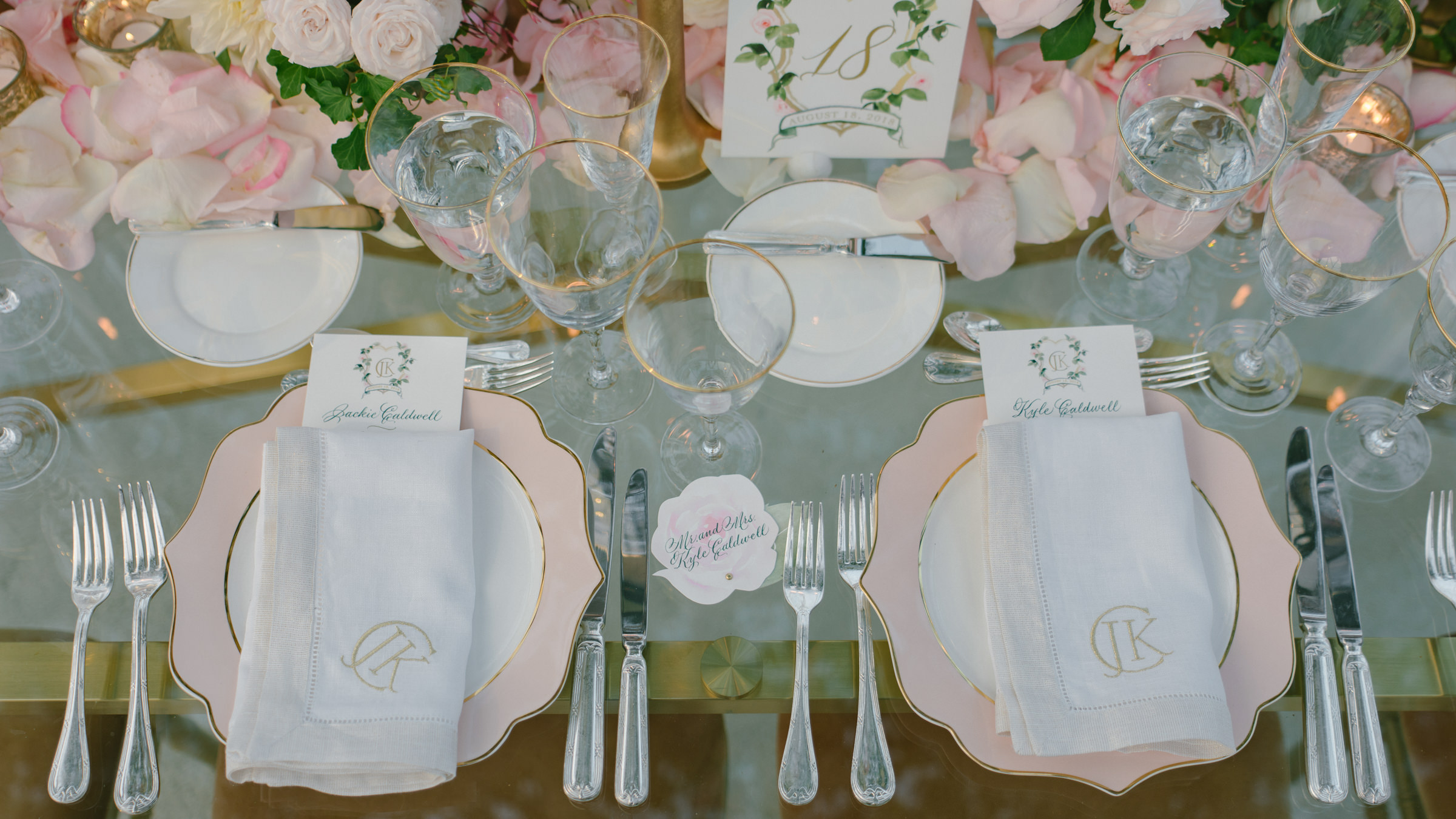 closeup of romantic reception table setting with stationery and monogrammed napkins - photo by Amy and Stuart Photography