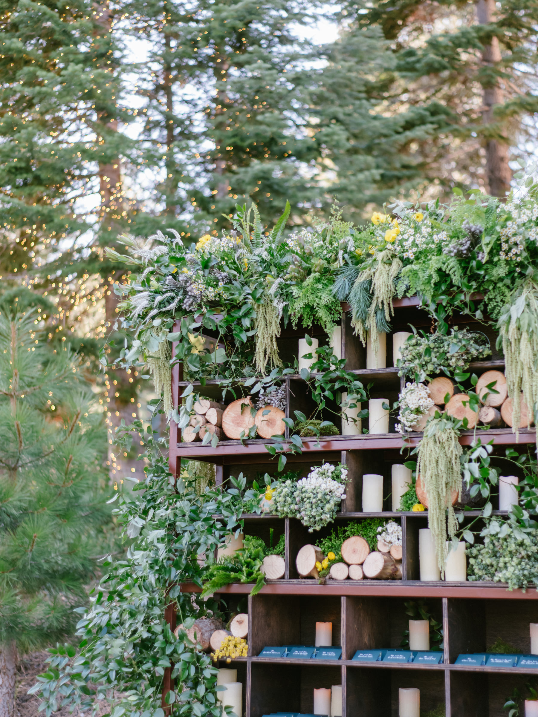 Decorative Shelves with logs and greenery for outdoor weddings  - photo by Amy and Stuart Photography