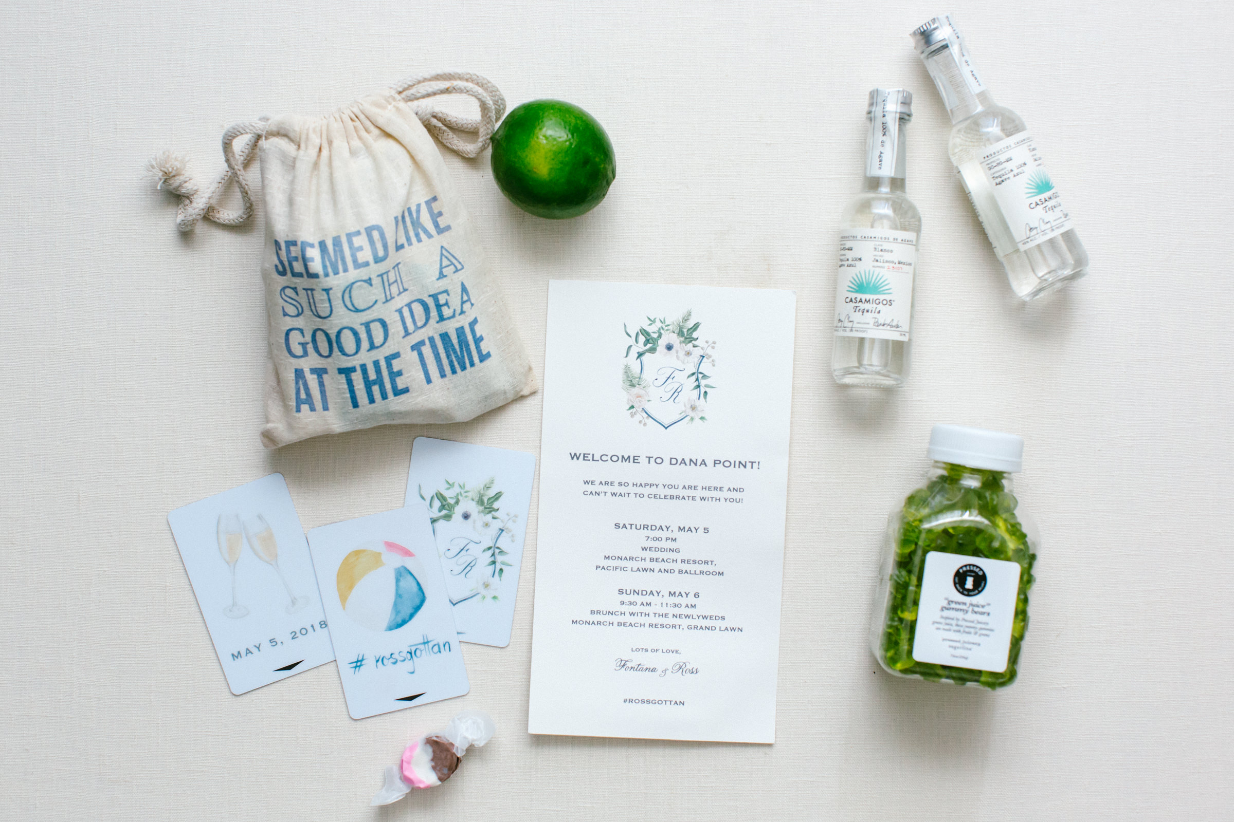 Flatlay of drink themed party favors and stationery - photo by Amy and Stuart Photography