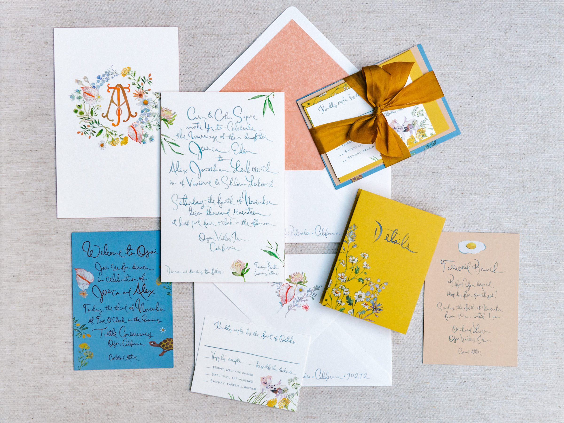 Flatlay of stationery in blue gold and peach - photo by Amy and Stuart Photography