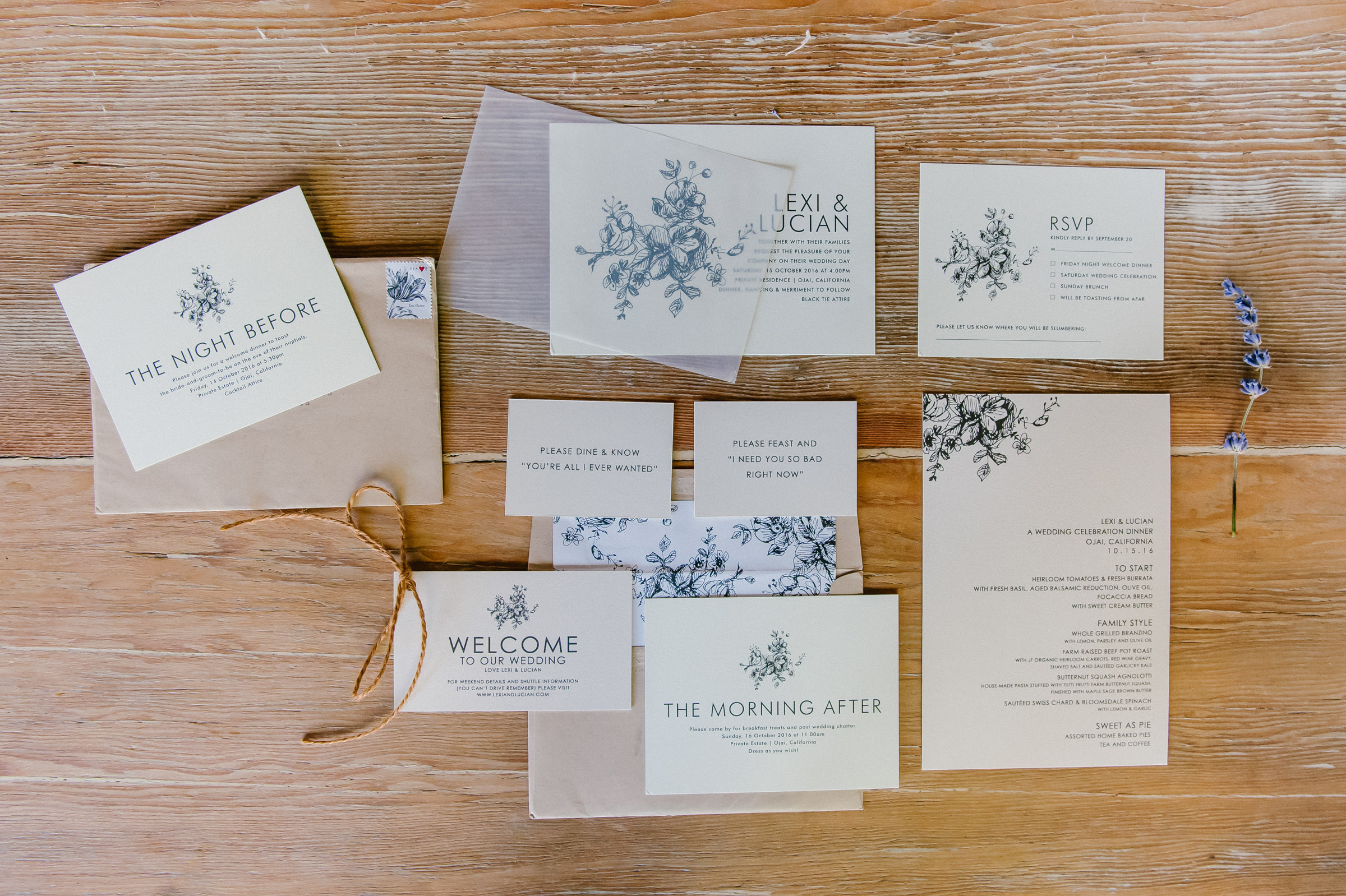 Flatlay of wedding stationery with lavender - photo by Amy and Stuart Photography