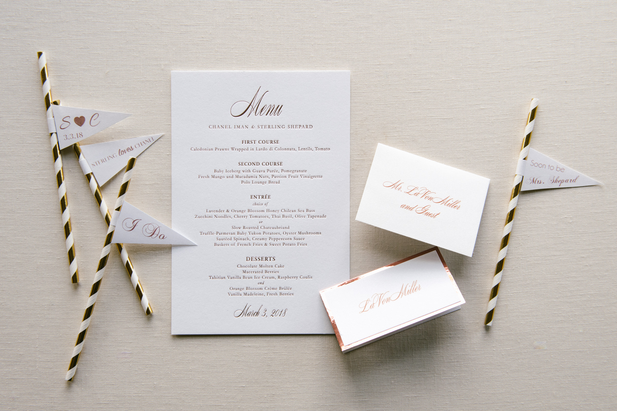 Flatlay with menu and seating markers - photo by Amy and Stuart Photography