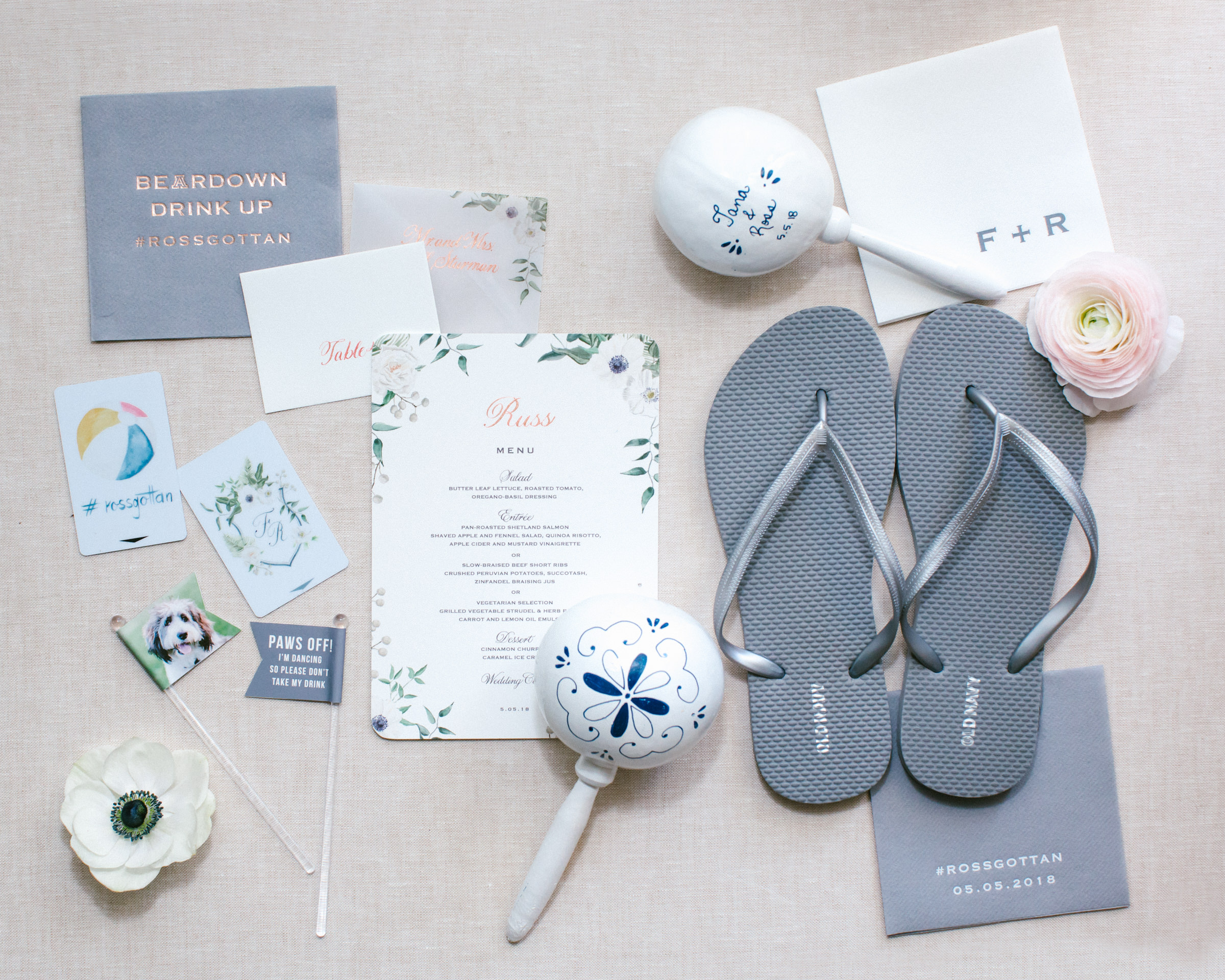 Flatlay with stationery flip flops and maracas - photo by Amy and Stuart Photography