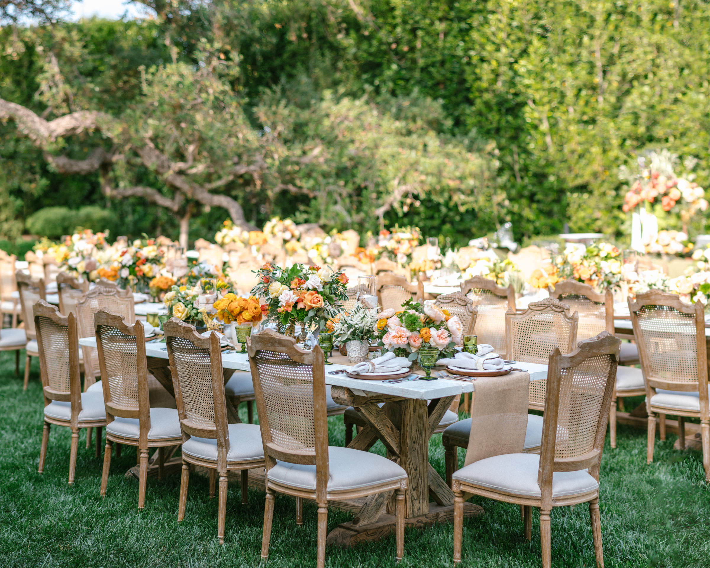 Garden reception tables with abundant floral decor - photo by Amy and Stuart Photography