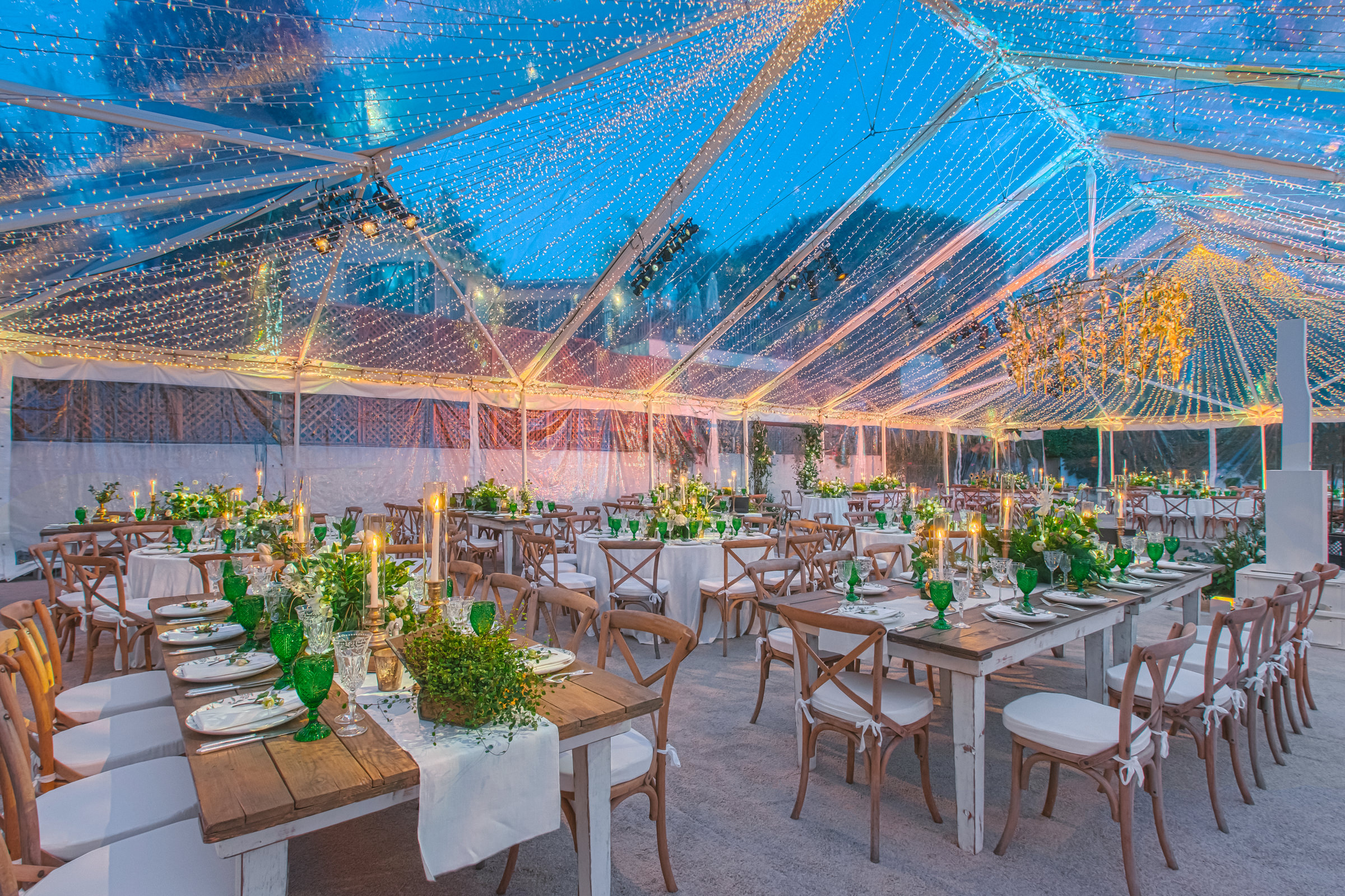 Green and yellow reception decor outdoors under tent - photo by Amy and Stuart Photography