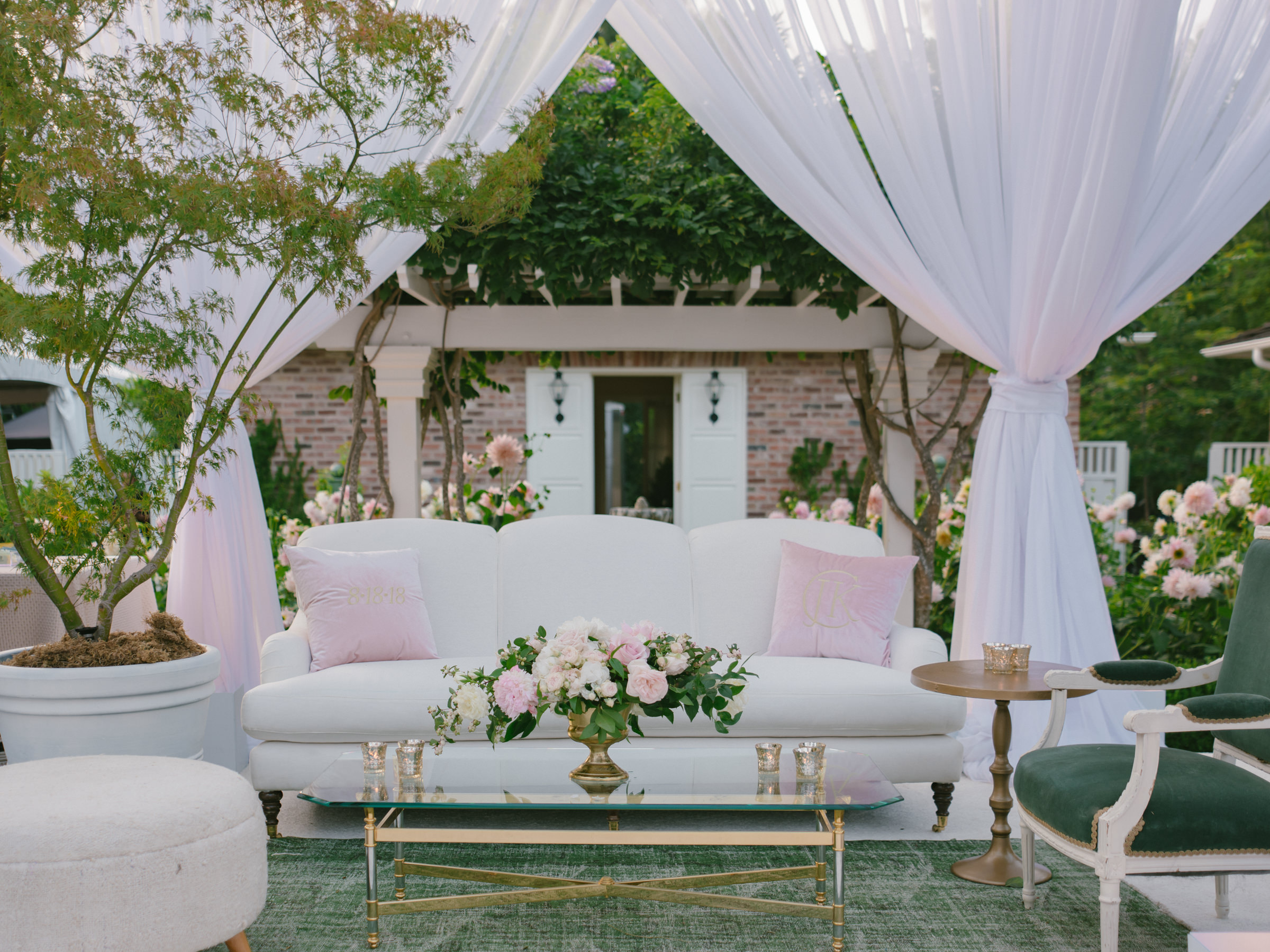 Outdoor reception decor in blush and white with pink roses - photo by Amy and Stuart Photography