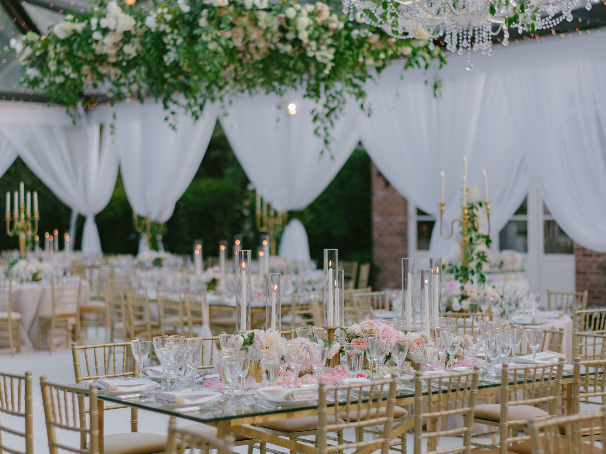 outdoor reception tables against white drapes and floral decor - photo by Amy and Stuart Photography