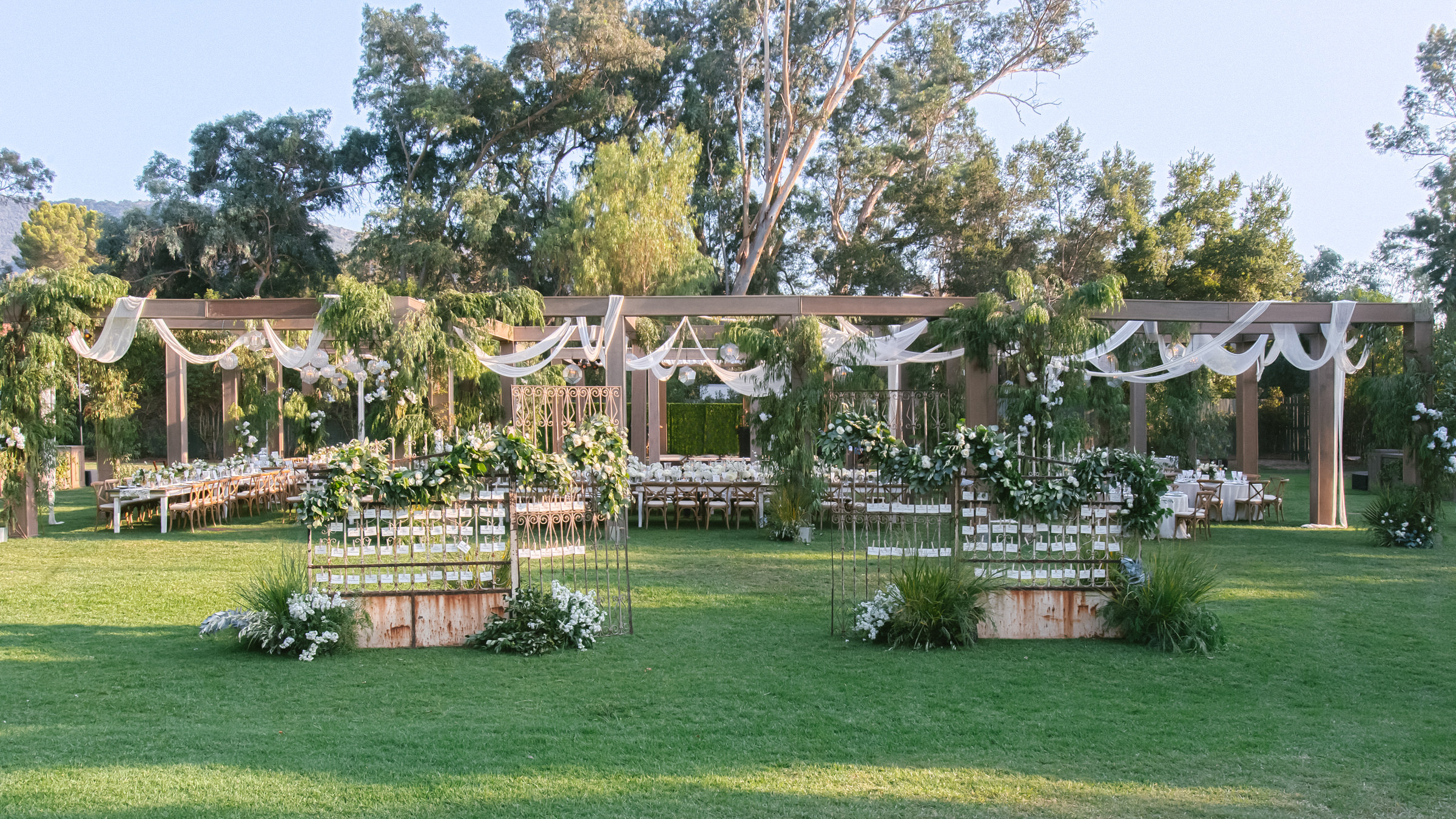 outdoor wedding reception venue with rustic arbor - photo by Amy and Stuart Photography, Los Angeles