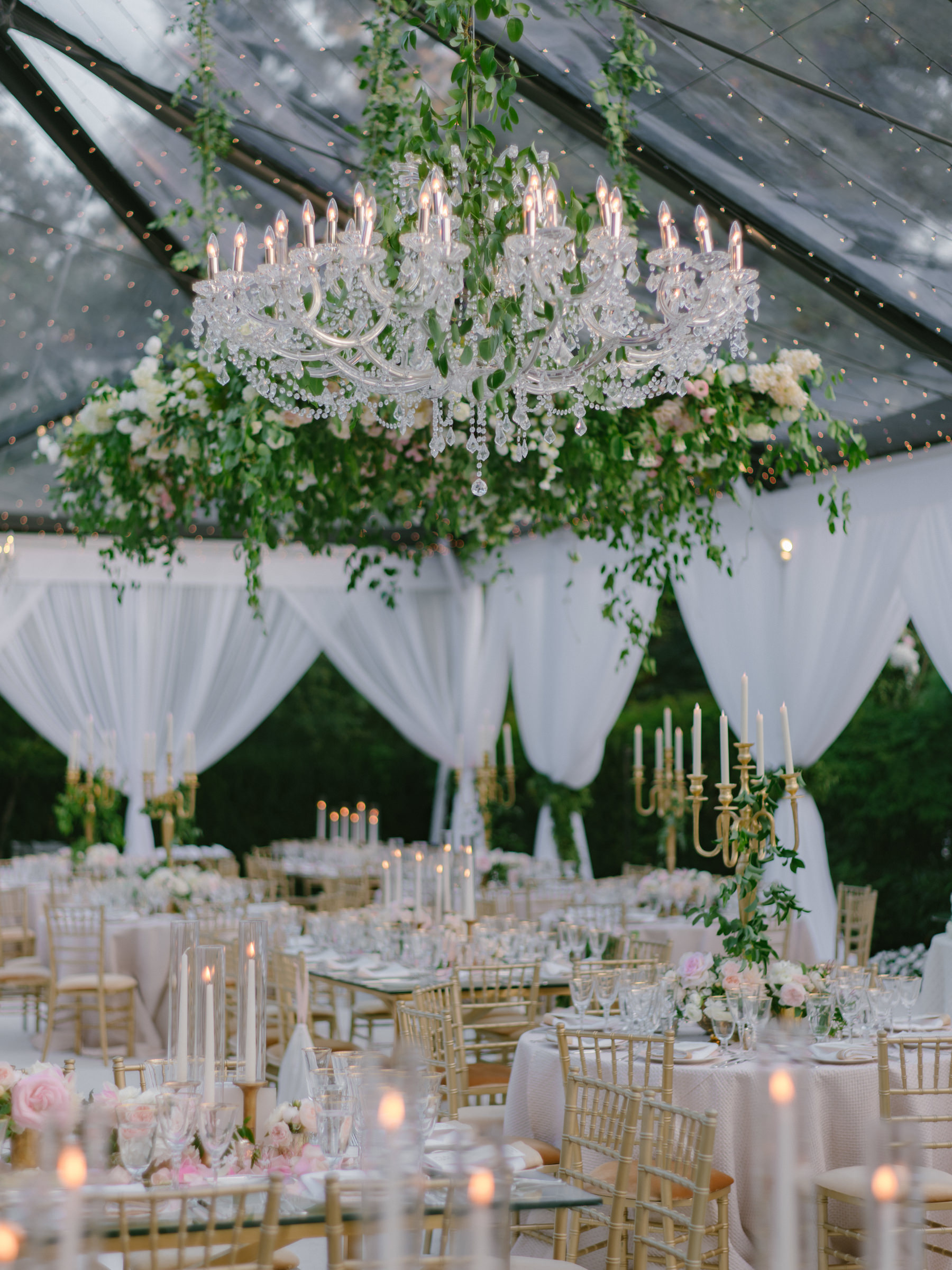 Pink and white reception decor with chandeliers and candlelight - photo by Amy and Stuart Photography