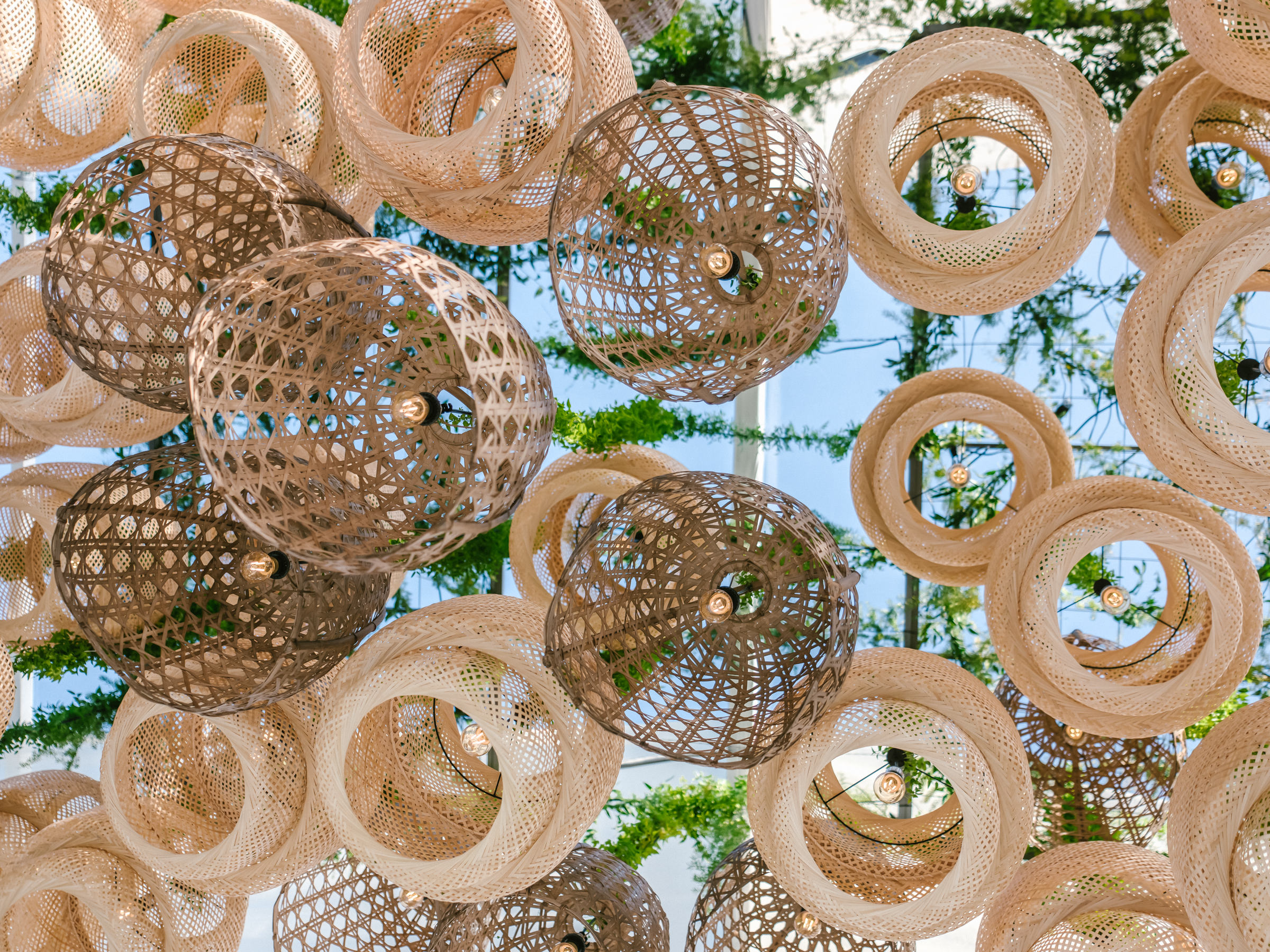 rattan wedding reception lighting - photo by Amy and Stuart Photography, Los Angeles