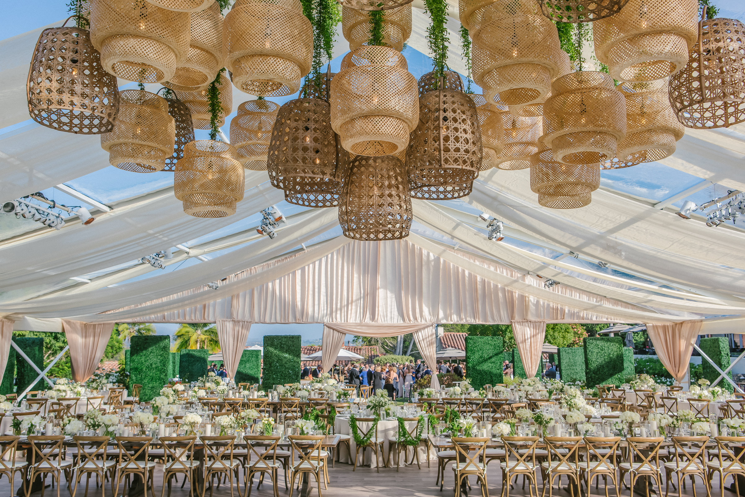 Reception decor with woven natural material hanging lights - photo by Amy and Stuart Photography