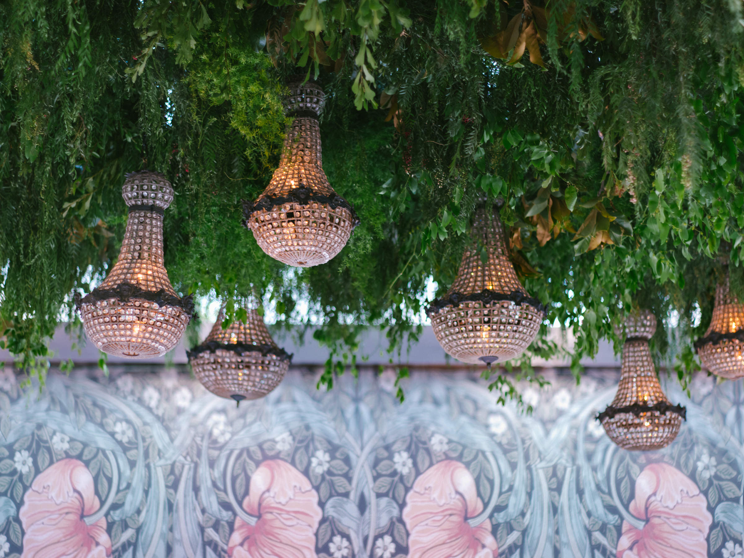 Reception detail of glass light fixtures and art nouveau wallpaper - photo by Amy and Stuart Photography