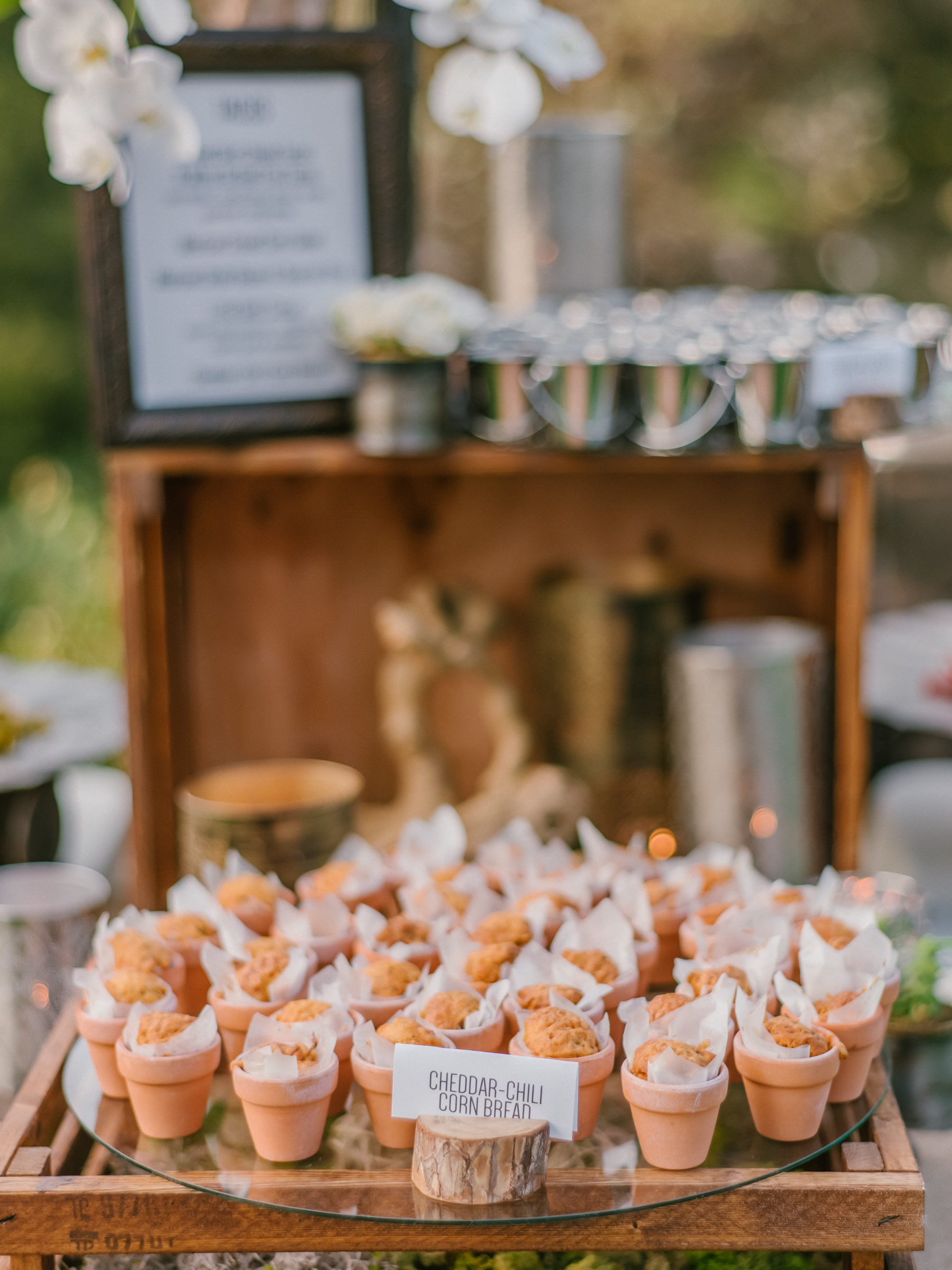 Reception menu cheddar chili corn bread in small flowerpots - photo by Amy and Stuart Photography