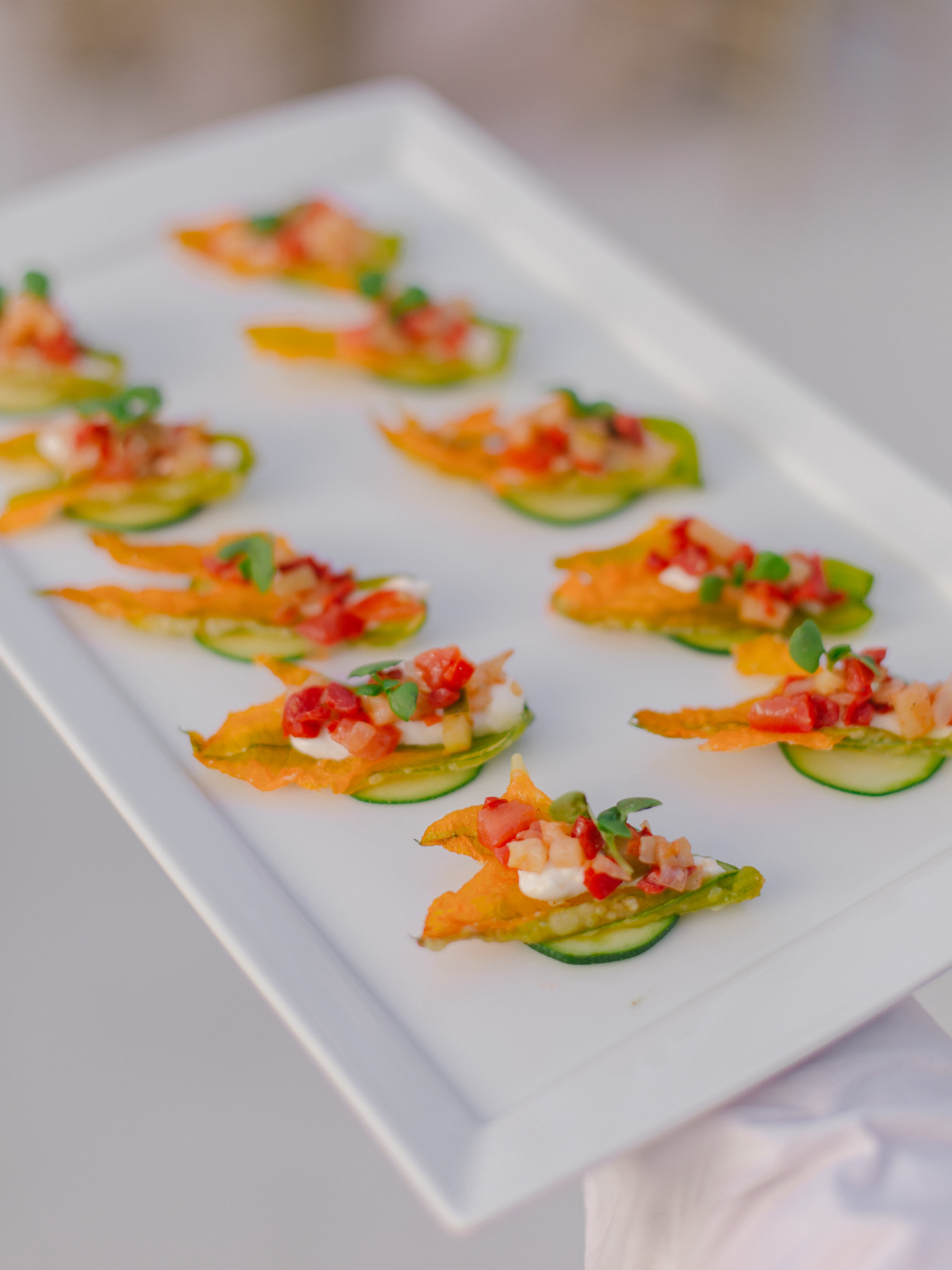 reception menu hors d'oeuvres on sliced cucumbers - photo by Amy and Stuart Photography