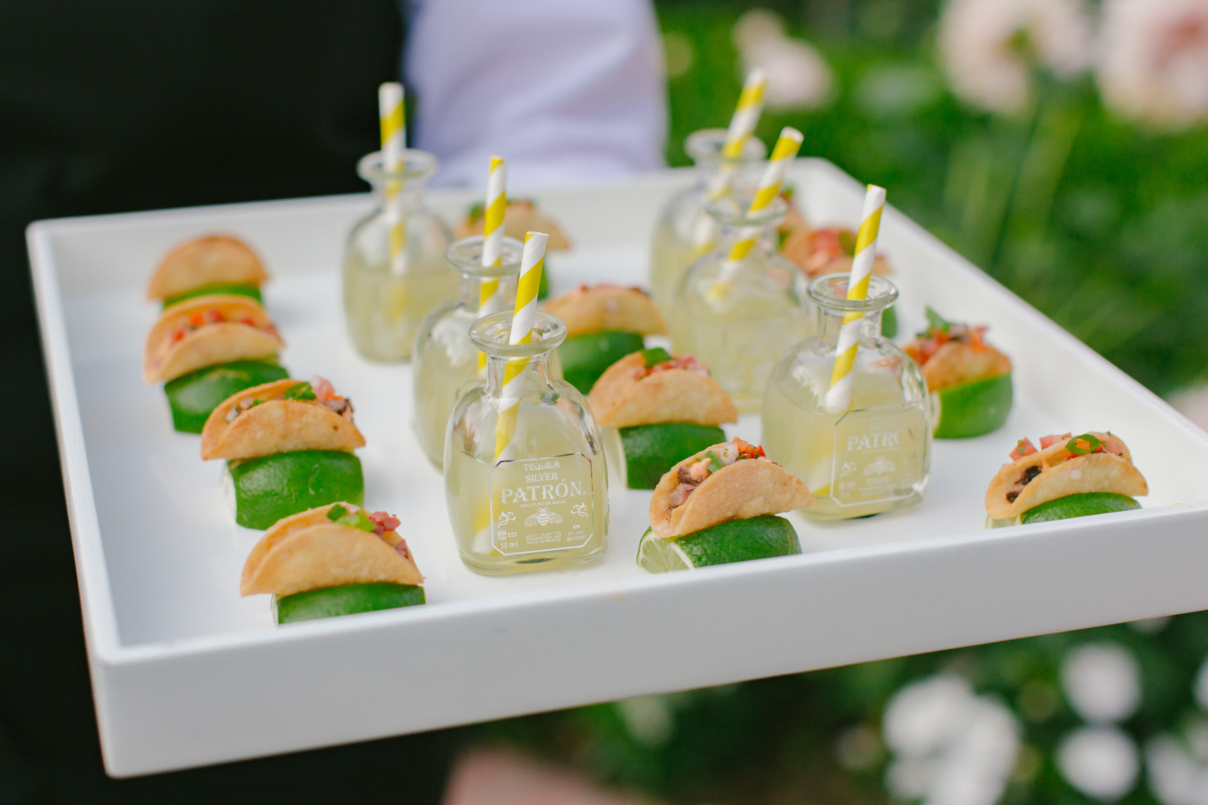Reception menu mini taco hors d'oeuvres with individual tequila bottles with straws - photo by Amy and Stuart Photography