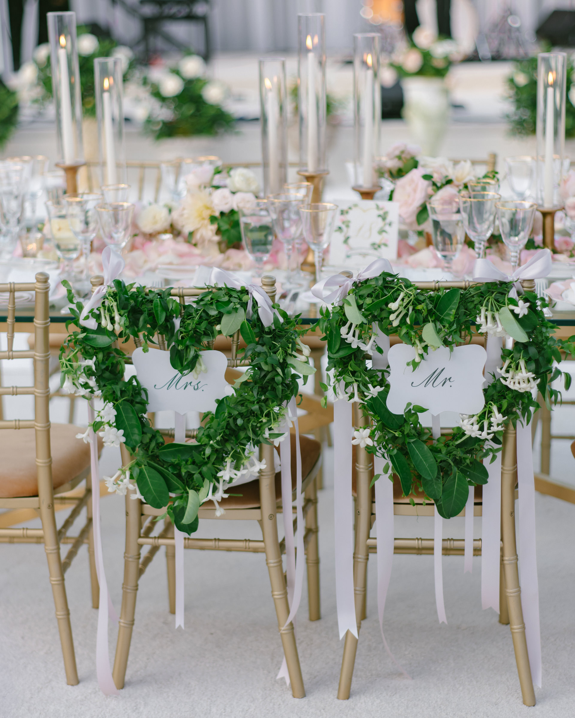 Reception table settings with Mr and Mrs heart shaped chair wreaths - photo by Amy and Stuart Photography