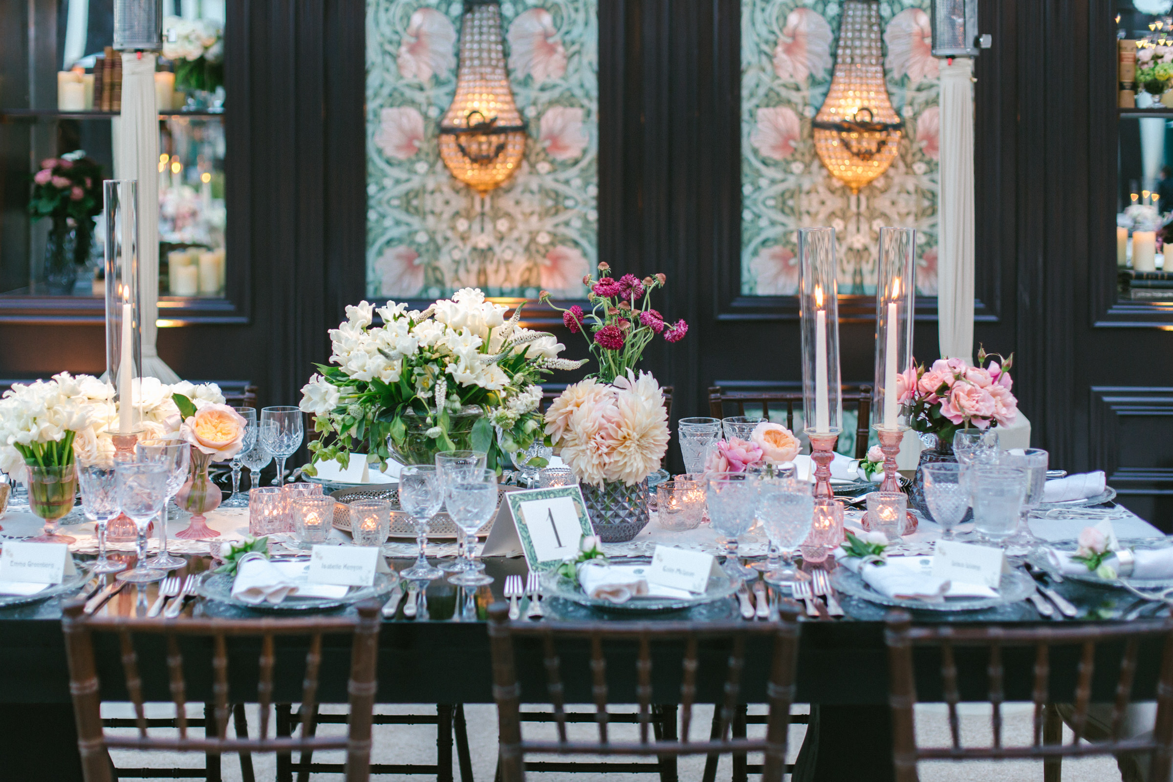 Reception table with floral decorations in art nouveau interior - photo by Amy and Stuart Photography