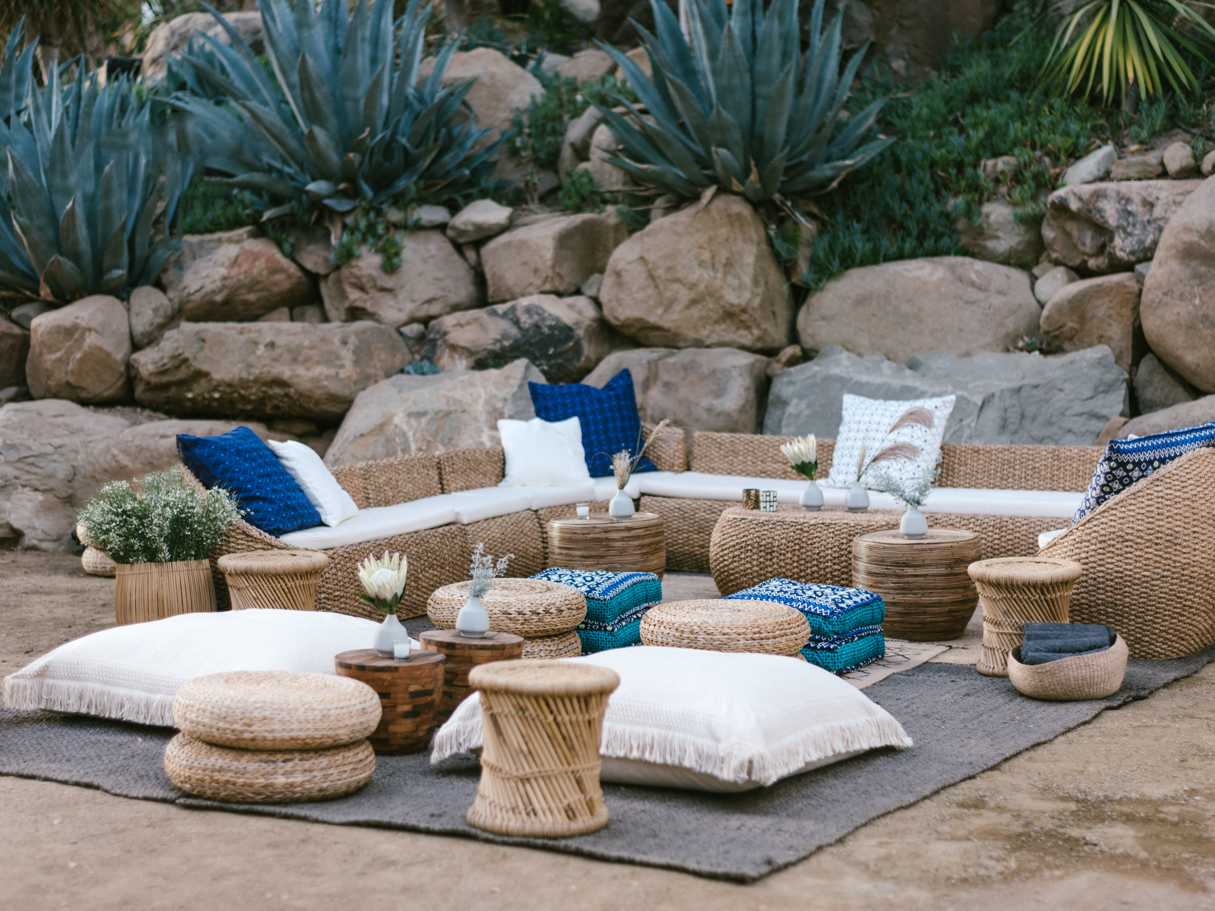 reception wicker seating outdoor tropical setting- photo by Amy and Stuart Photography