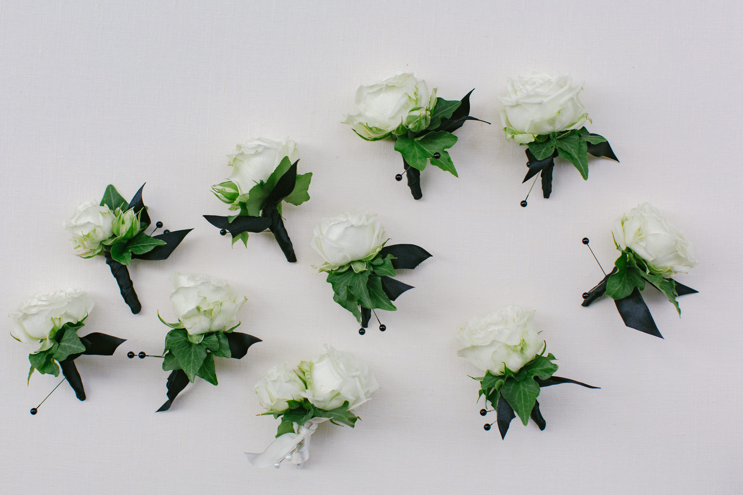 Rose boutonnieres ready to be pinned - photo by Amy and Stuart Photography