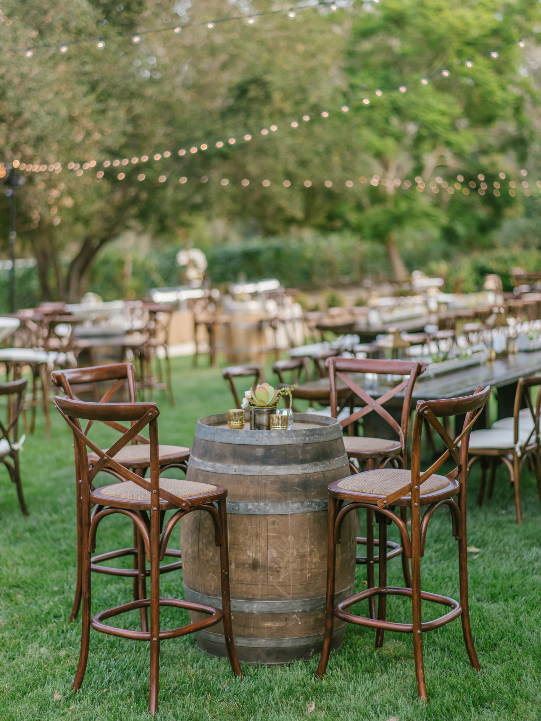 Rustic outdoor reception area with strings of lights - photo by Amy and Stuart Photography