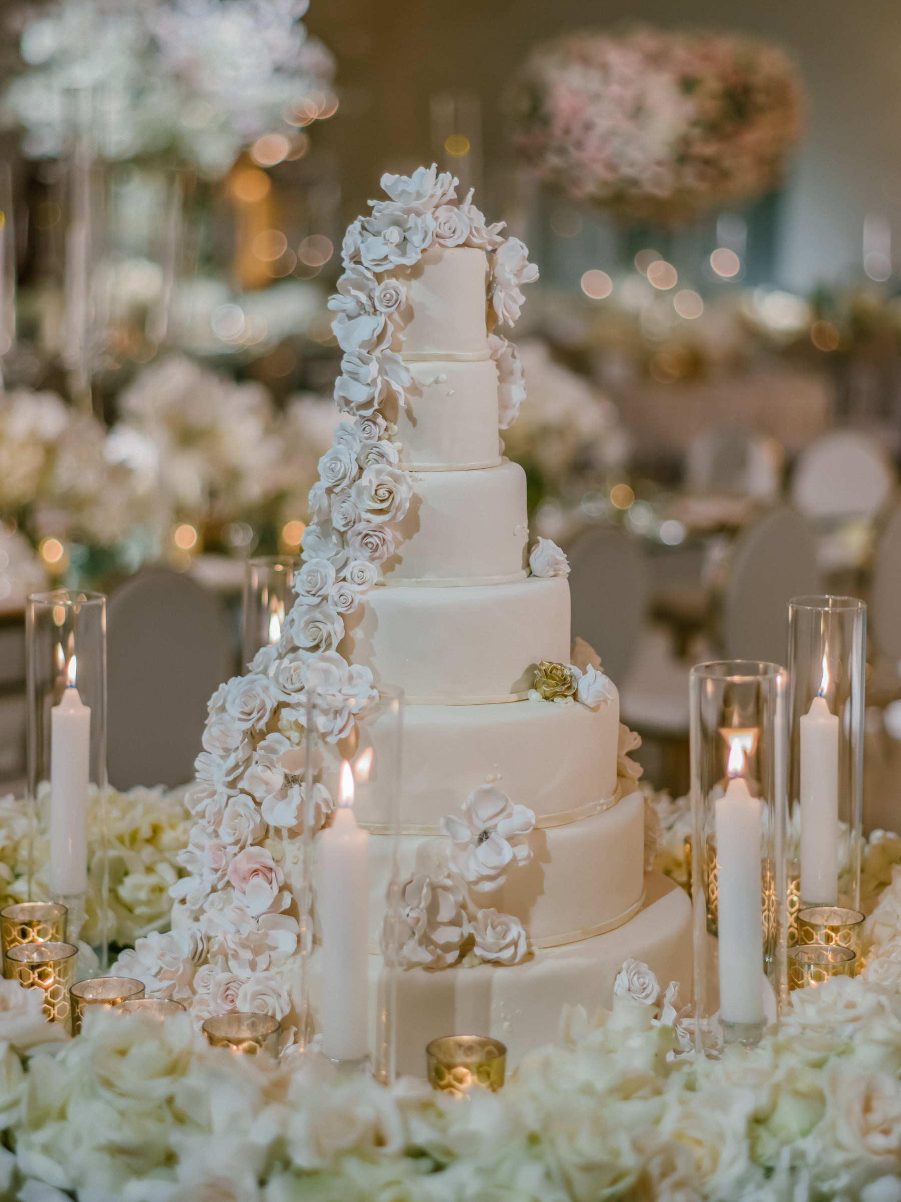 Seven-tier-wedding-cake-with-frosting-roses - photo by Amy and Stuart Photography