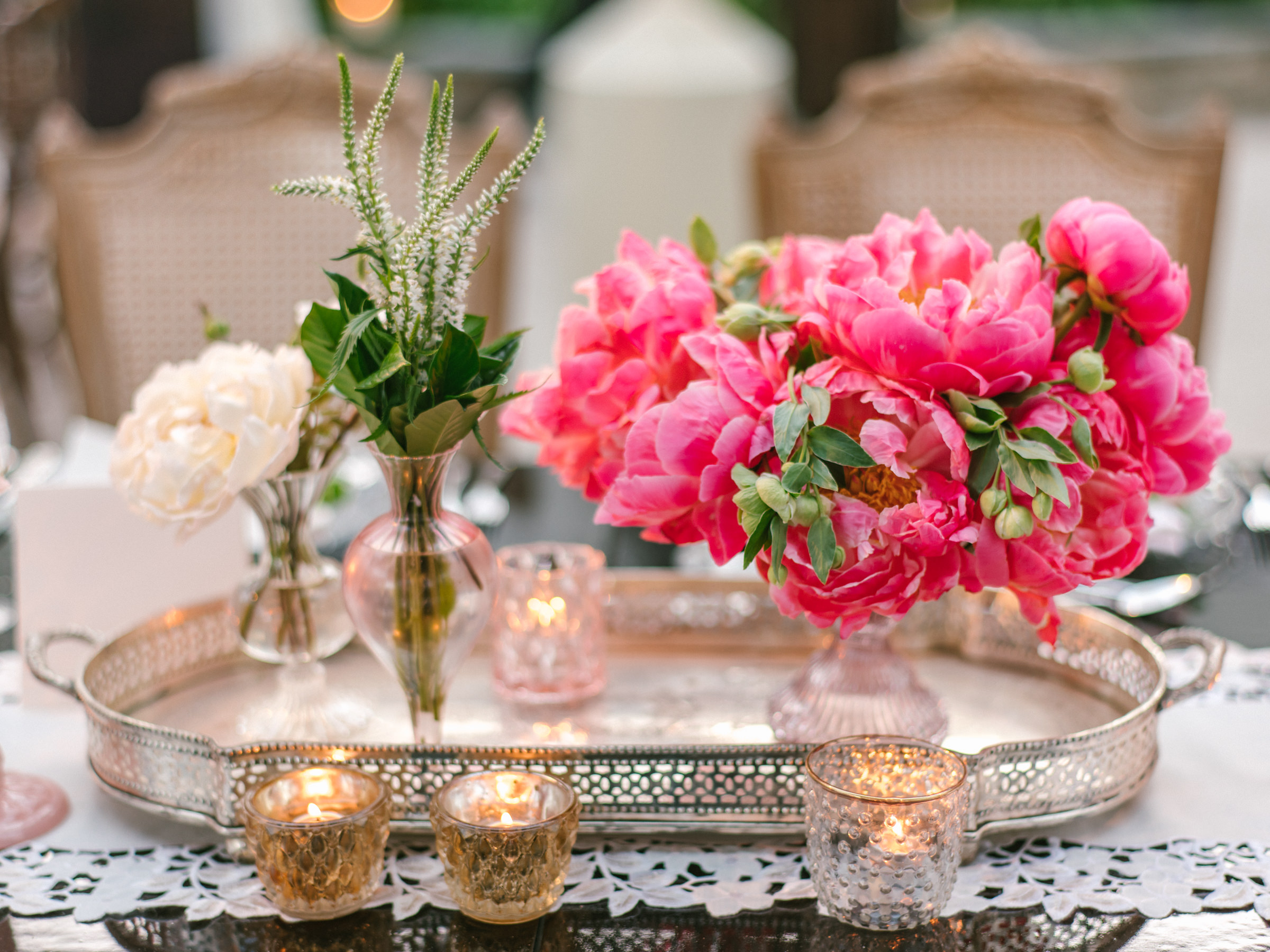 Silver filigree tray with crystal candle holders and ranunculuses - photo by Amy and Stuart Photography