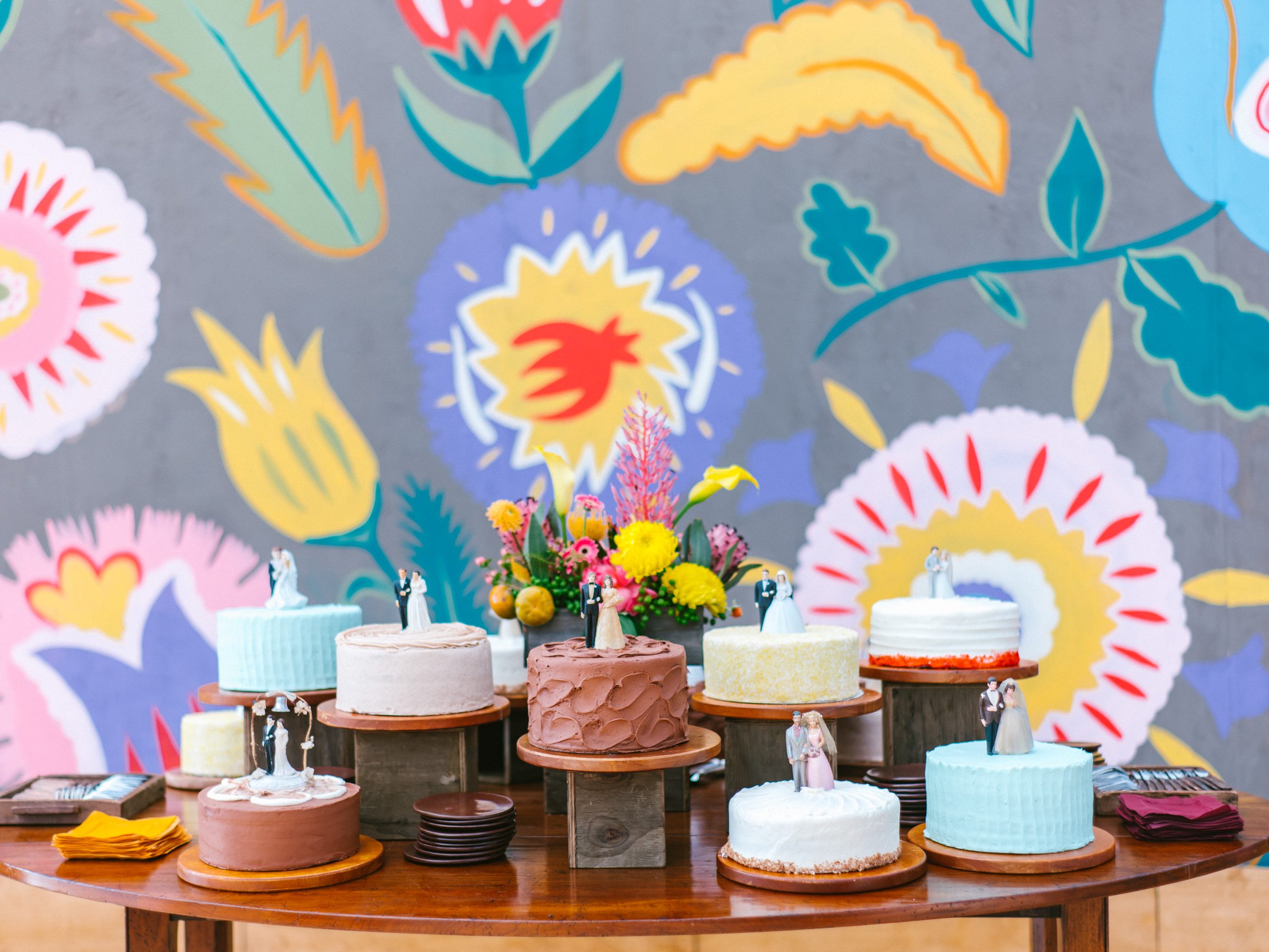 Small wedding cakes with toppers - photo by Amy and Stuart Photography